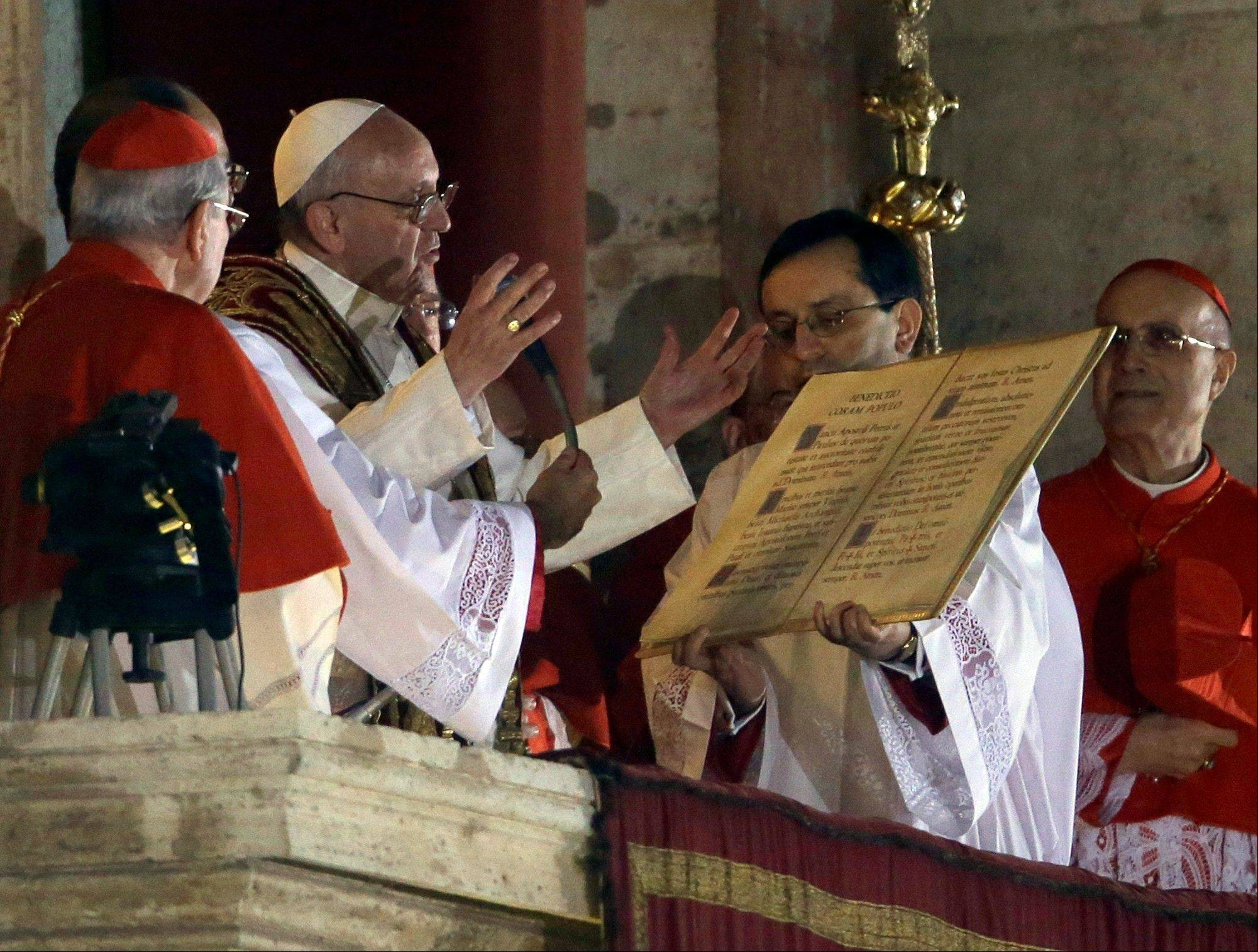 Pope Francis speaks from the central balcony Wednesday of St. Peter�s Basilica at the Vatican.