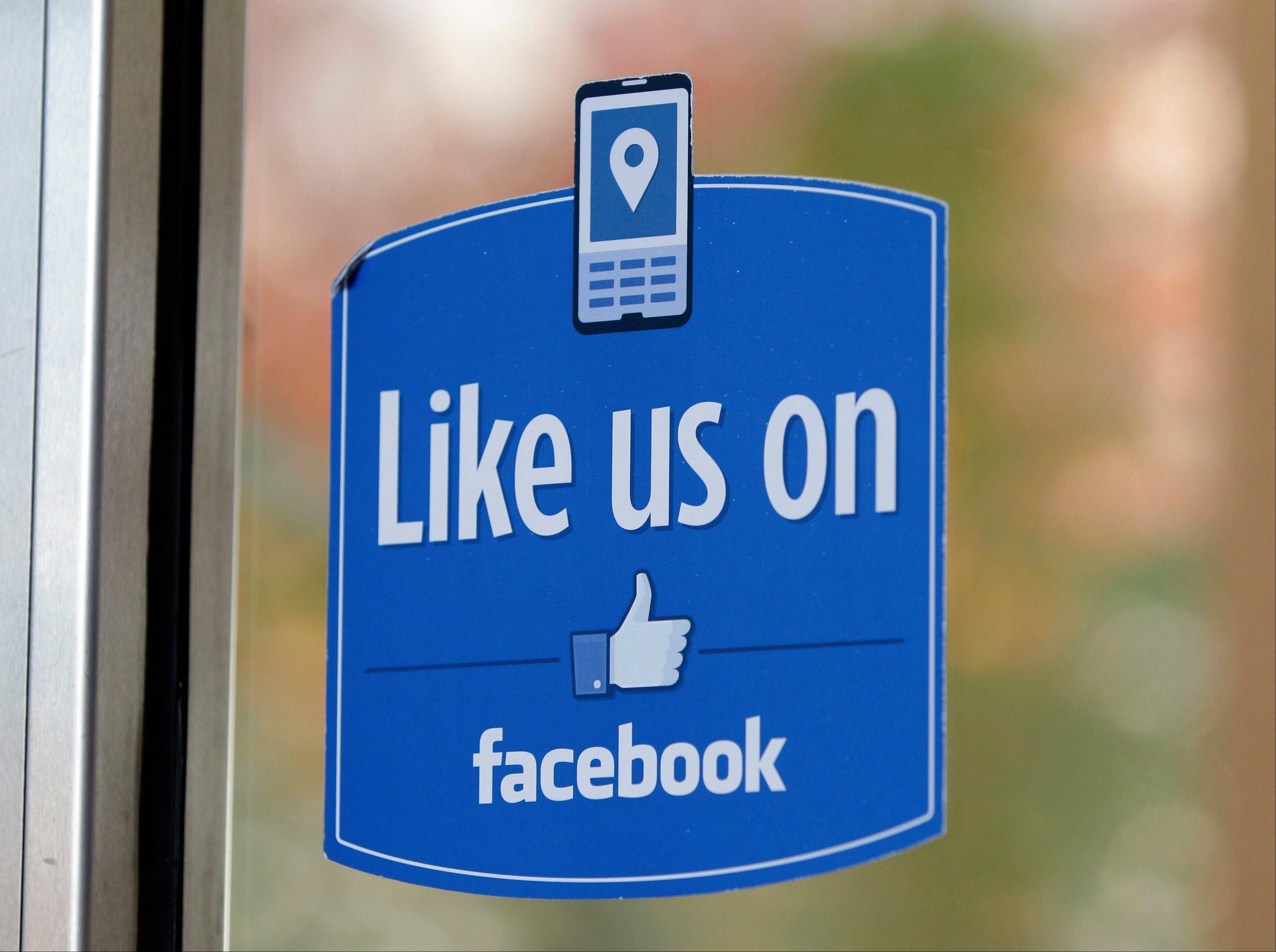 "A sign with Facebook's ""Like"" logo is posted at Facebook headquarters near the office for the company's User Operations Safety Team in Menlo Park, Calif."
