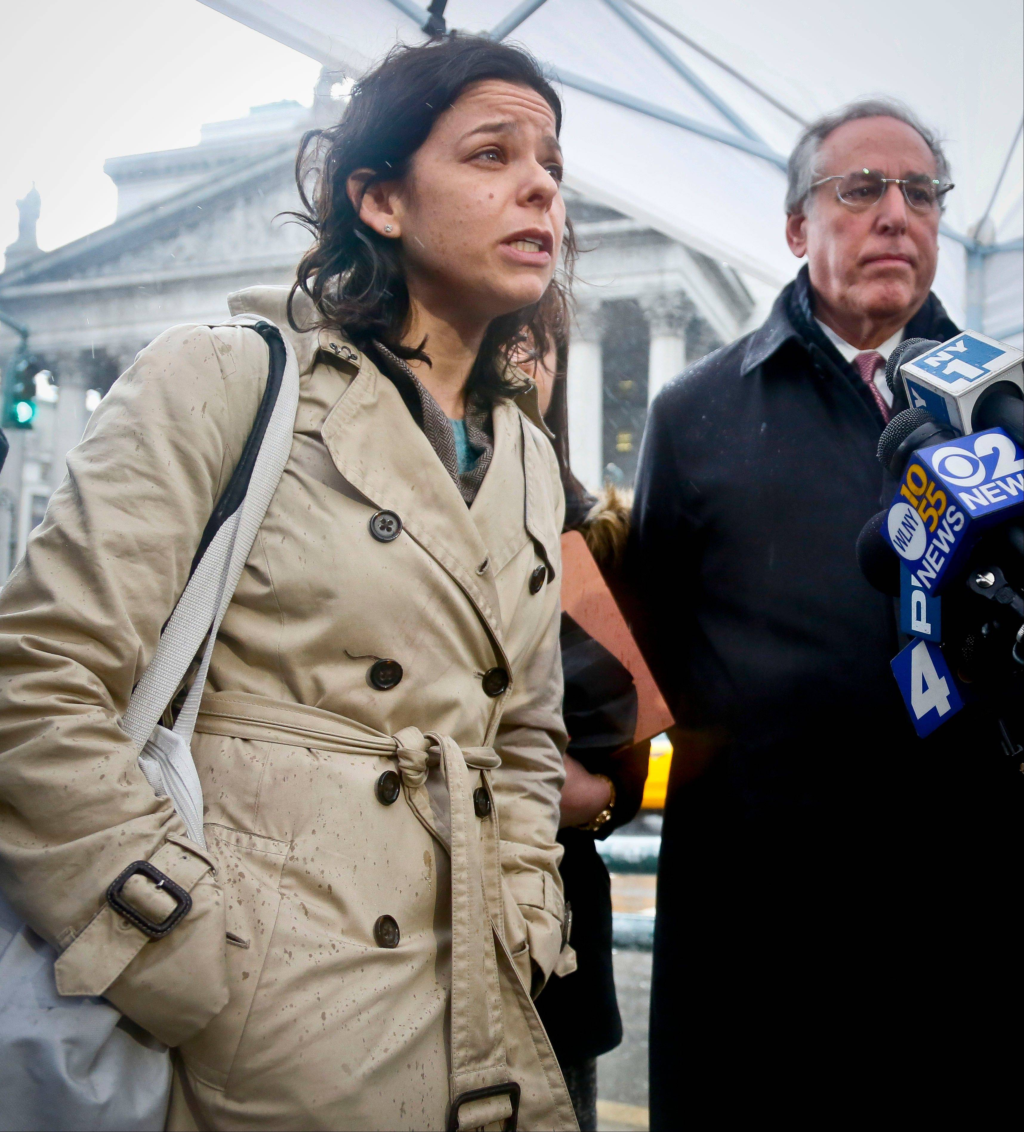 "Defense lawyers, Julia Gatto, left, and, Robert Baum, hold a news briefing on Tuesday, March 12, 2013 in New York. A federal jury convicted their client, New York City police officer Gilberto Valle, of charges he plotted to kidnap and cook women to dine on their ""girl meat."" Valle, 28, faces up to life in prison when he is sentenced on June 19. With the conviction, he loses his job as a police officer."