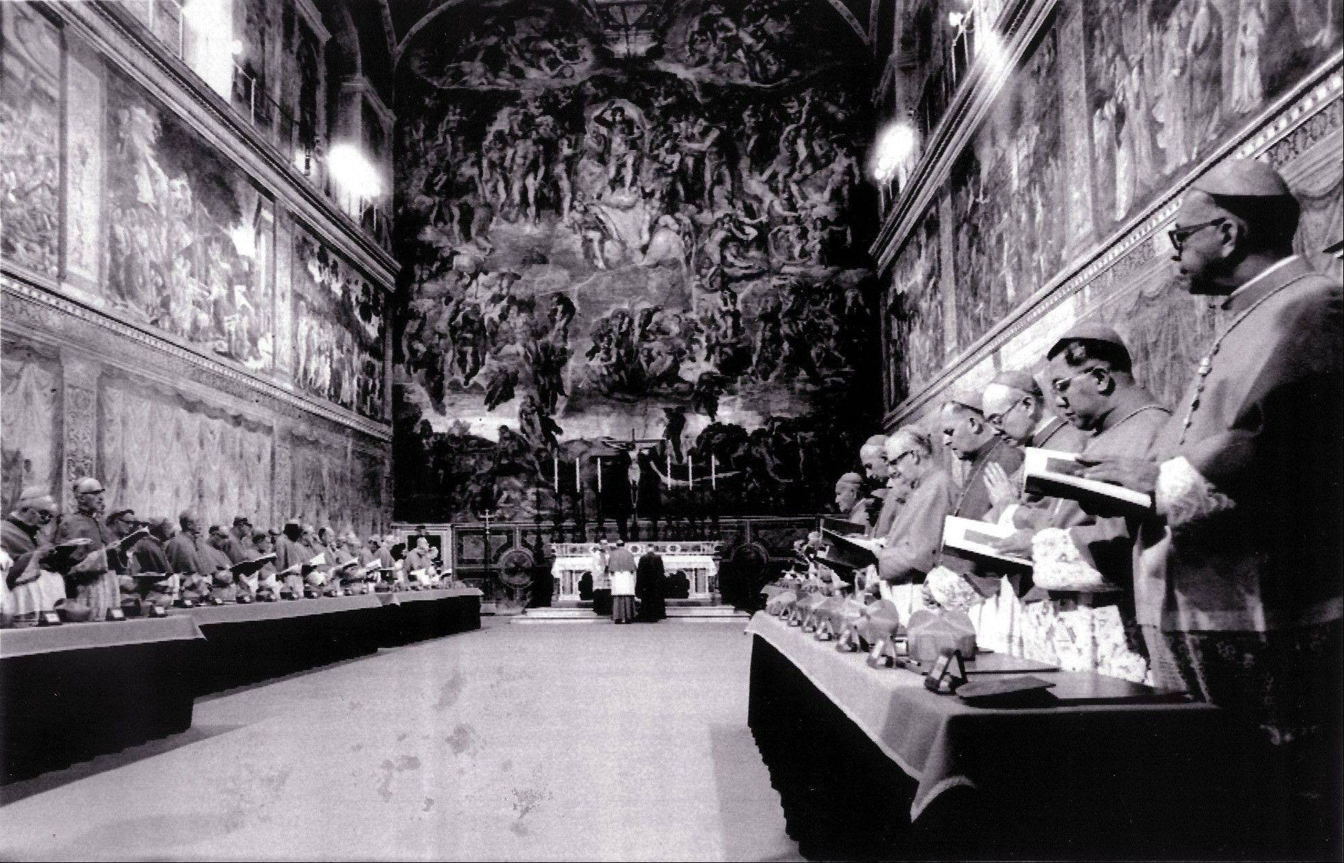 In this Oct. 14, 1978 file photo, cardinals stand in prayer inside the Sistine Chapel after they entered the conclave area for electing the successor of late John Paul I. The papal conclave is steeped in mystery — and the church likes it that way.