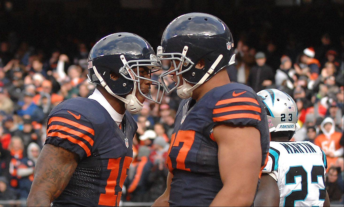 Bears wide receiver Brandon Marshall (15) congratulates teammate Kellen Davis after Davis caught a touchdown pass against Carolina at Soldier Field. The Bears cut Davis on Wednesday.