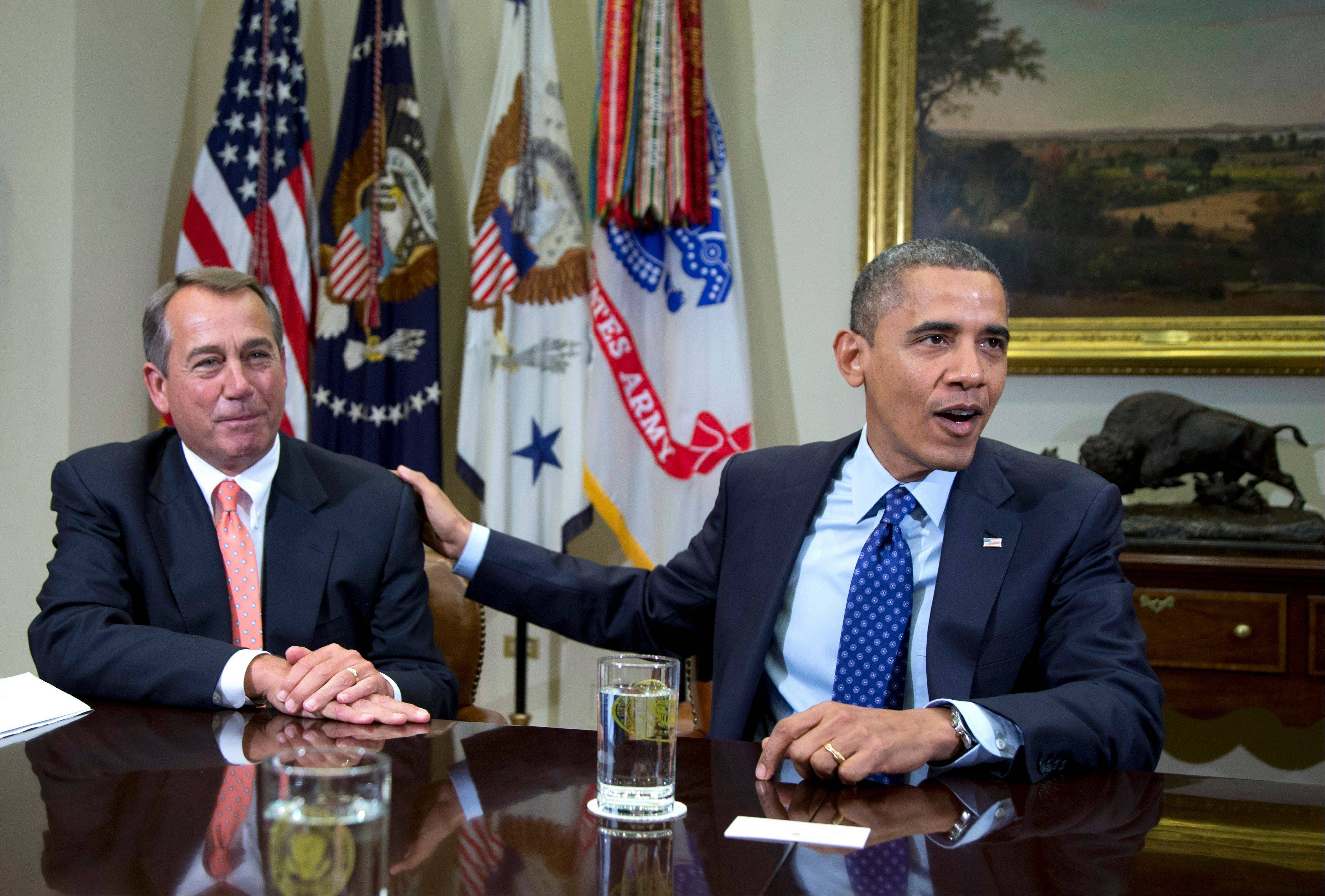 President Barack Obama acknowledges House Speaker John Boehner of Ohio while speaking to reporters in the Roosevelt Room of the White House in Washington, as he hosted a meeting of the bipartisan, bicameral leadership of Congress to discuss the deficit and economy.