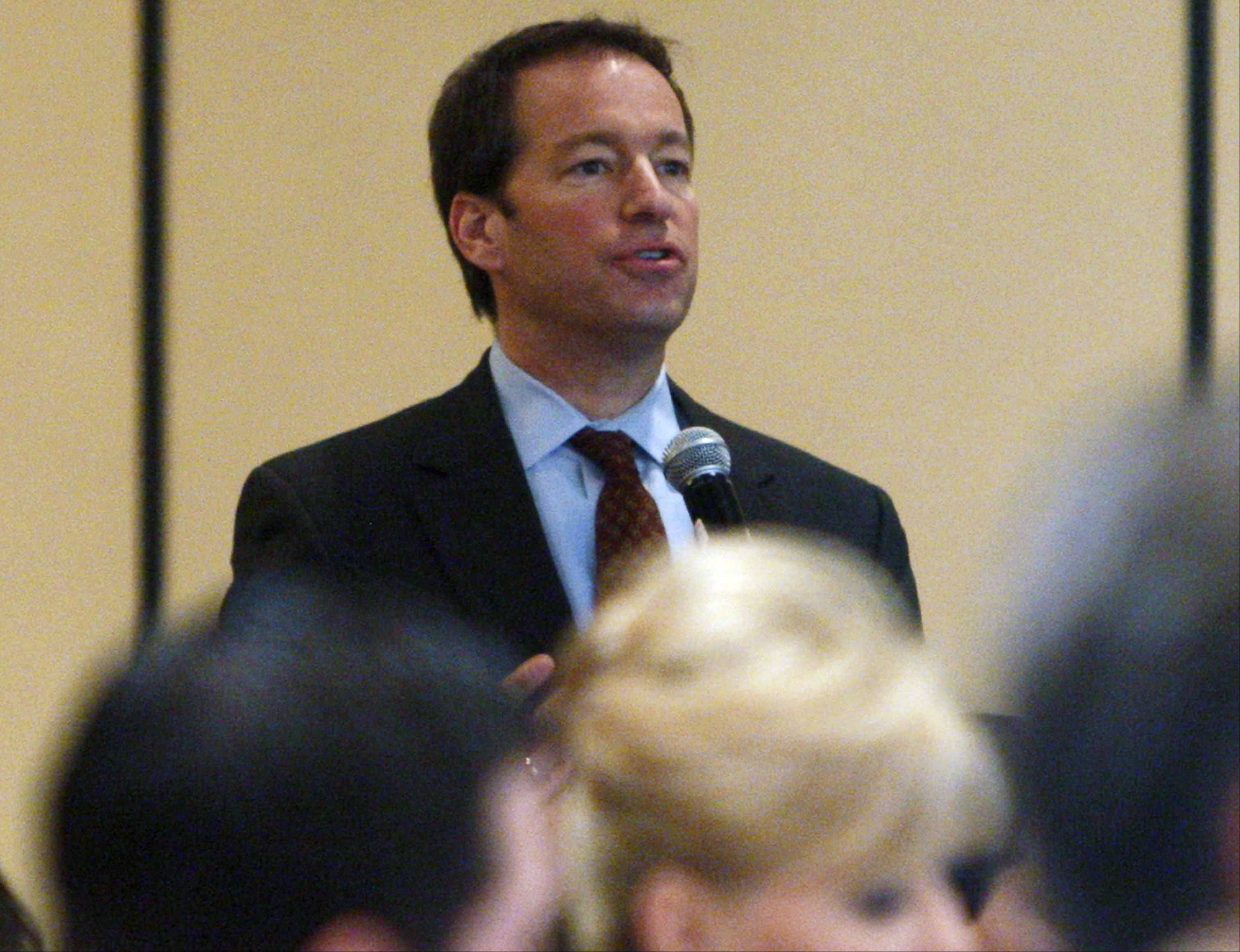 During the 2010 GOP retreat, Rep. Peter Roskam of Wheaton asks President Barack Obama, not pictured, a question as he addresses Republican lawmakers at the GOP House Issues Conference. Roskam and Obama are former colleagues from the Illinois General Assembly.