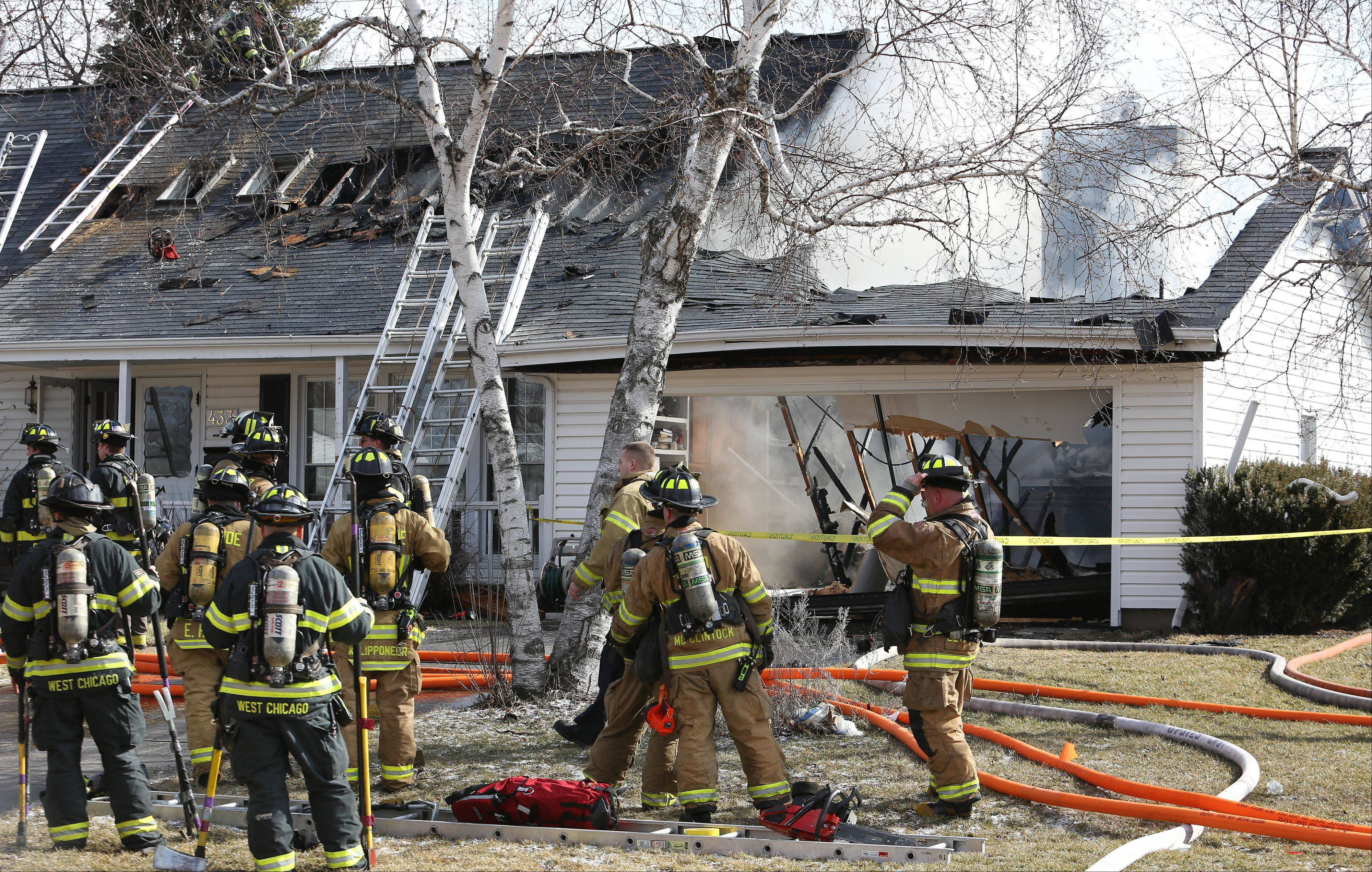Carol Stream firefighters were assisted by crews from several nearby towns Wednesday as they battled a house fire on the 400 block of N. Blackhawk Drive.