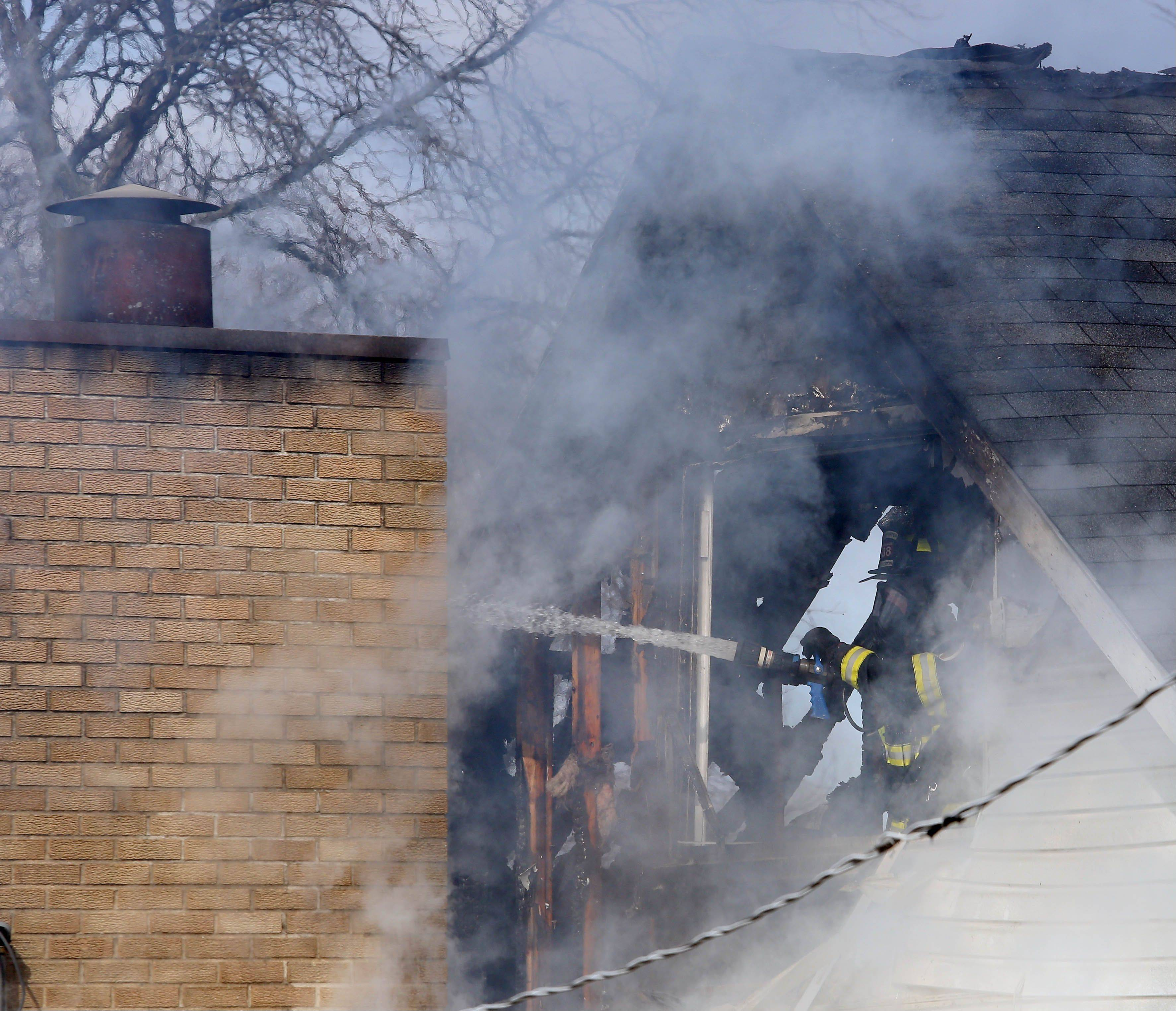 Carol Stream firefighters responded to a house fire shortly before 10 a.m. Wednesday on the 400 block of N. Blackhawk Drive.