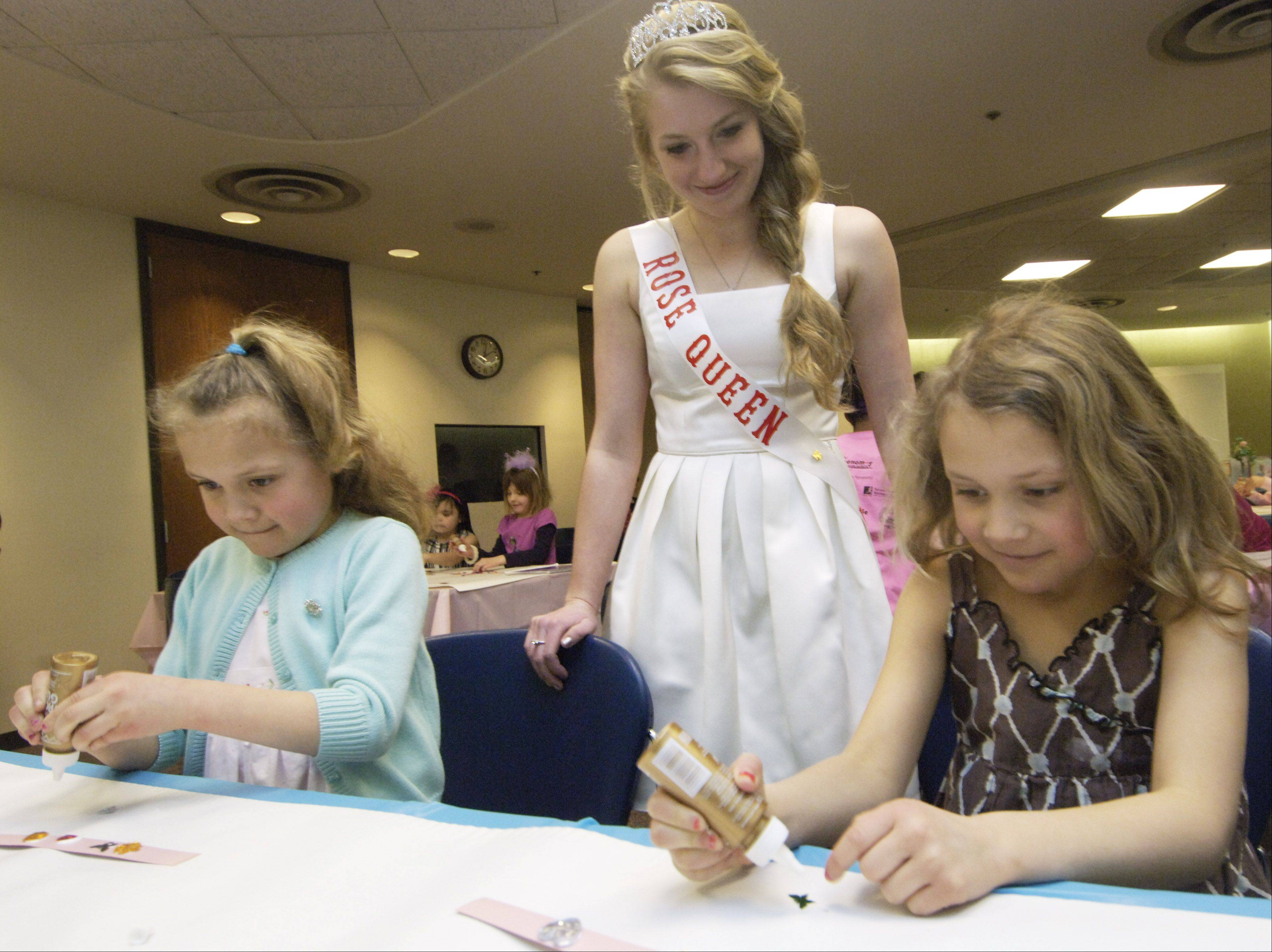 The Rose Queen is the guest of honor at the annual Rose Queen Tea with little girls who may have princess dreams of their own.