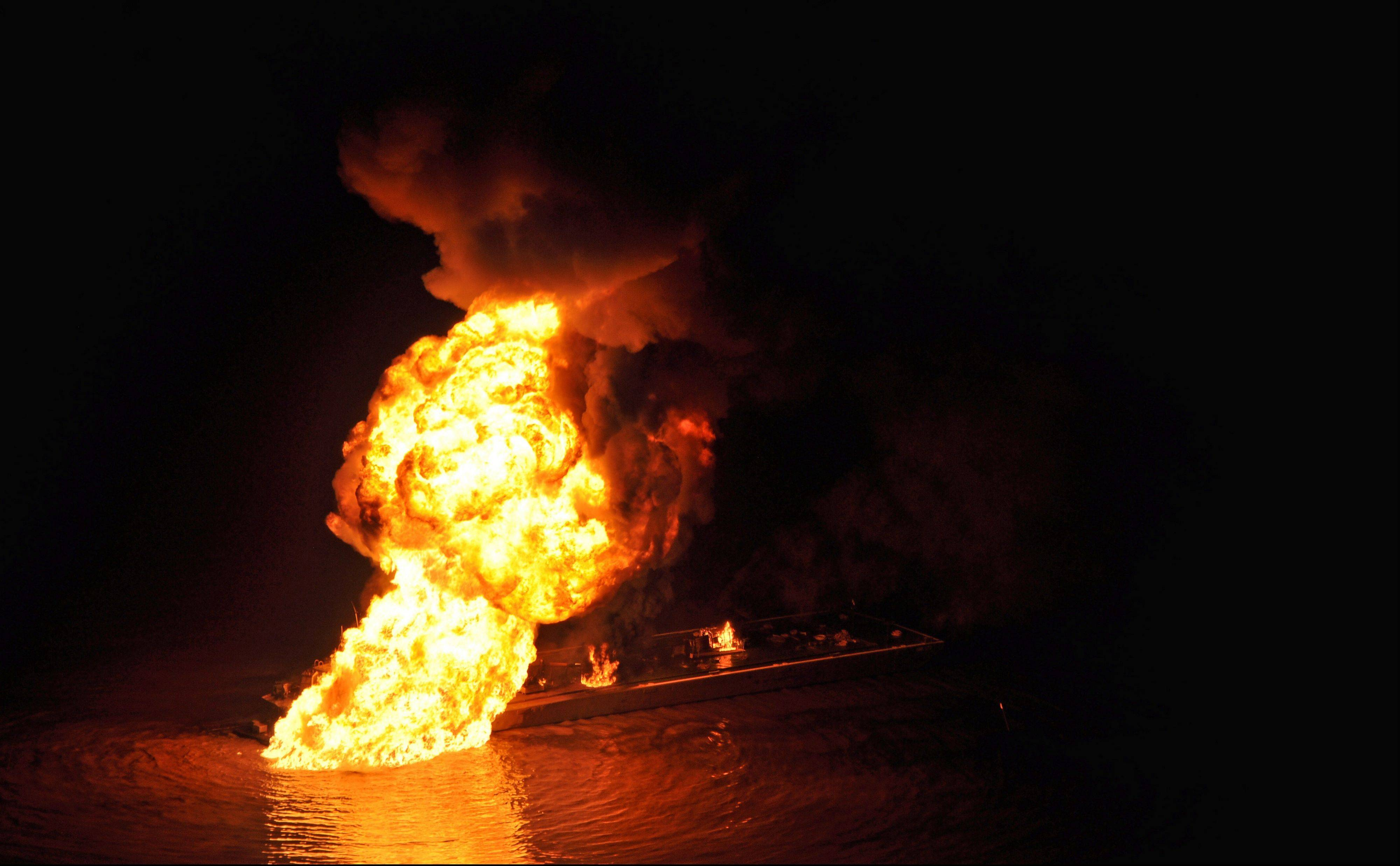 This image provided by the U.S. Coast Guard shows a pipeline burning after a collision near Bayou Perot 30 miles south of New Orleans, Tuesday March 12, 2012. The pipeline fire that was ignited when the pipe was hit by a tug boat pushing an oil barge burned into the early morning hours Wednesday in a bayou south of New Orleans.