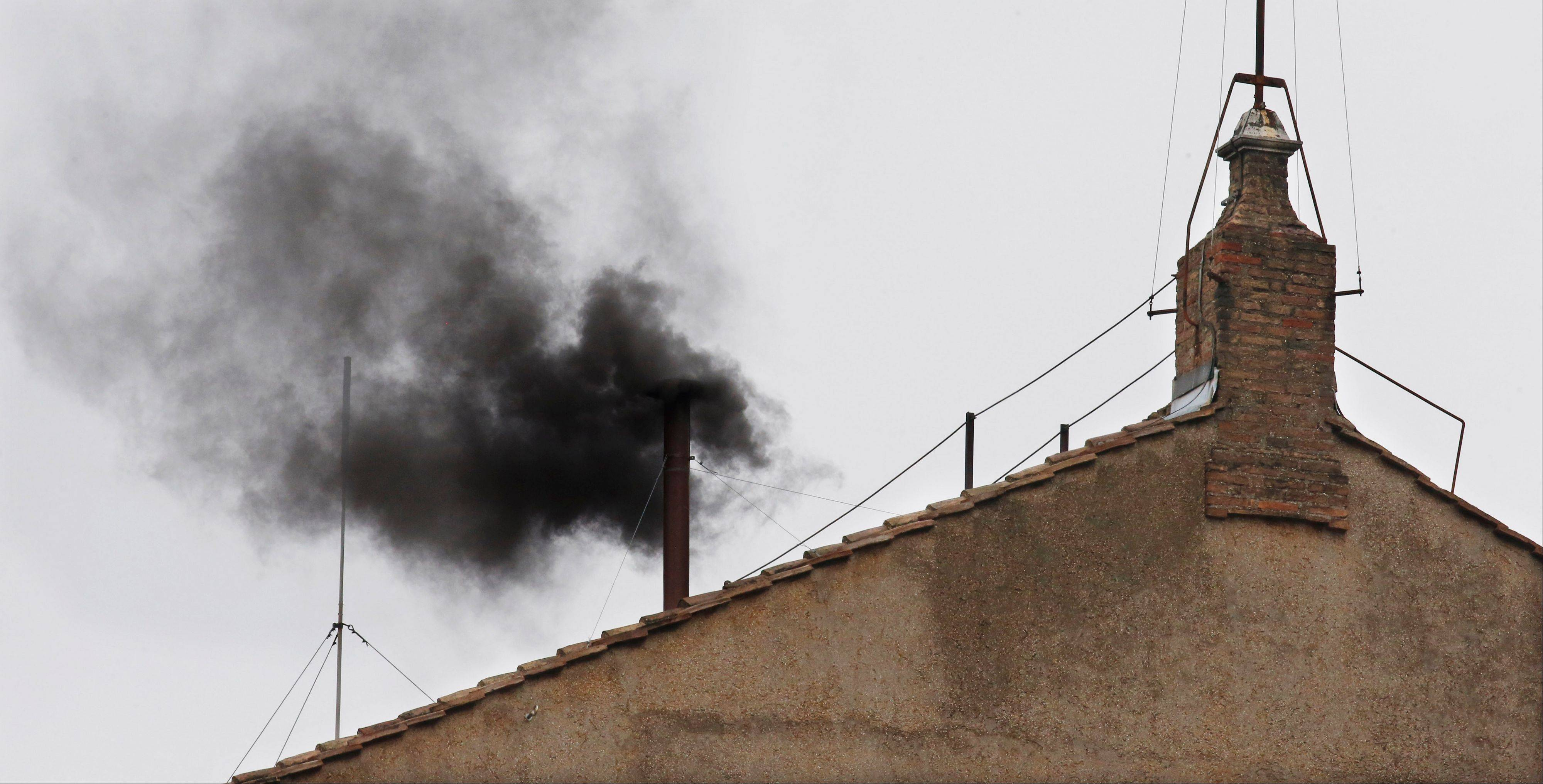 Black smoke emerges from the chimney on the Sistine Chapel as cardinals voted on the second day of the conclave to elect a pope. Black smoke indicating that no pope was elected was made by adding cartridges containing potassium perchlorate, anthracene (a component of coal tar), and sulfur to the burned ballots.