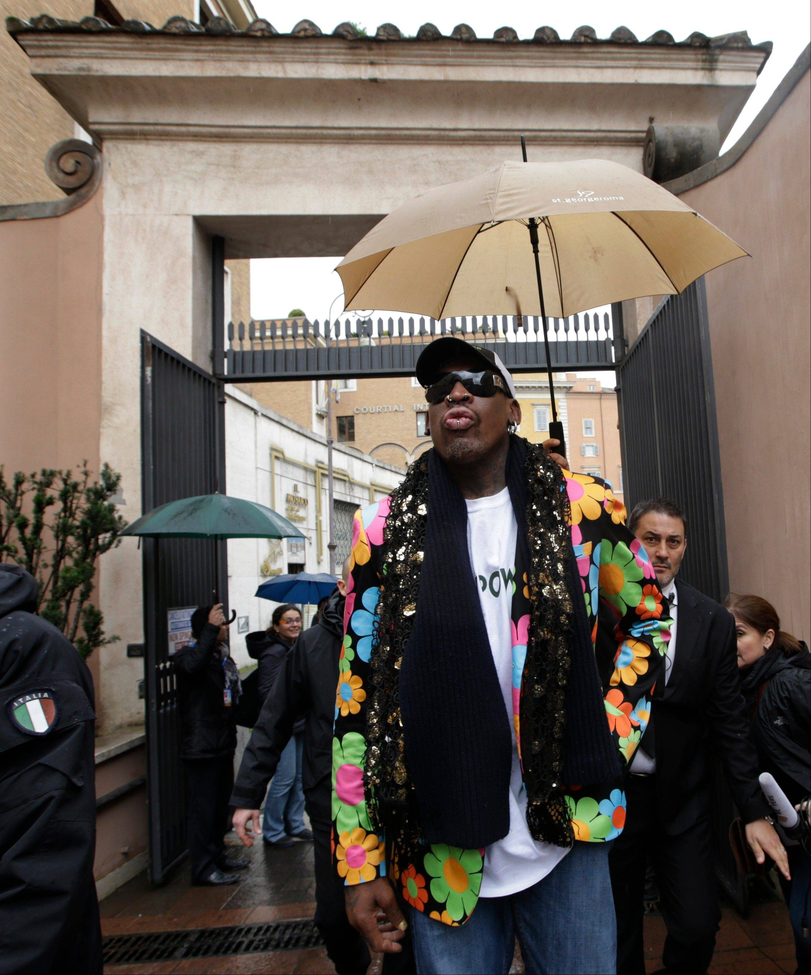 Former NBA star Dennis Rodman walks down a street near St. Peter's Square at the Vatican, Wednesday, March 13, 2013. Rodman is in Rome to promote the papal candidacy of Cardinal Peter Turkson of Ghana.