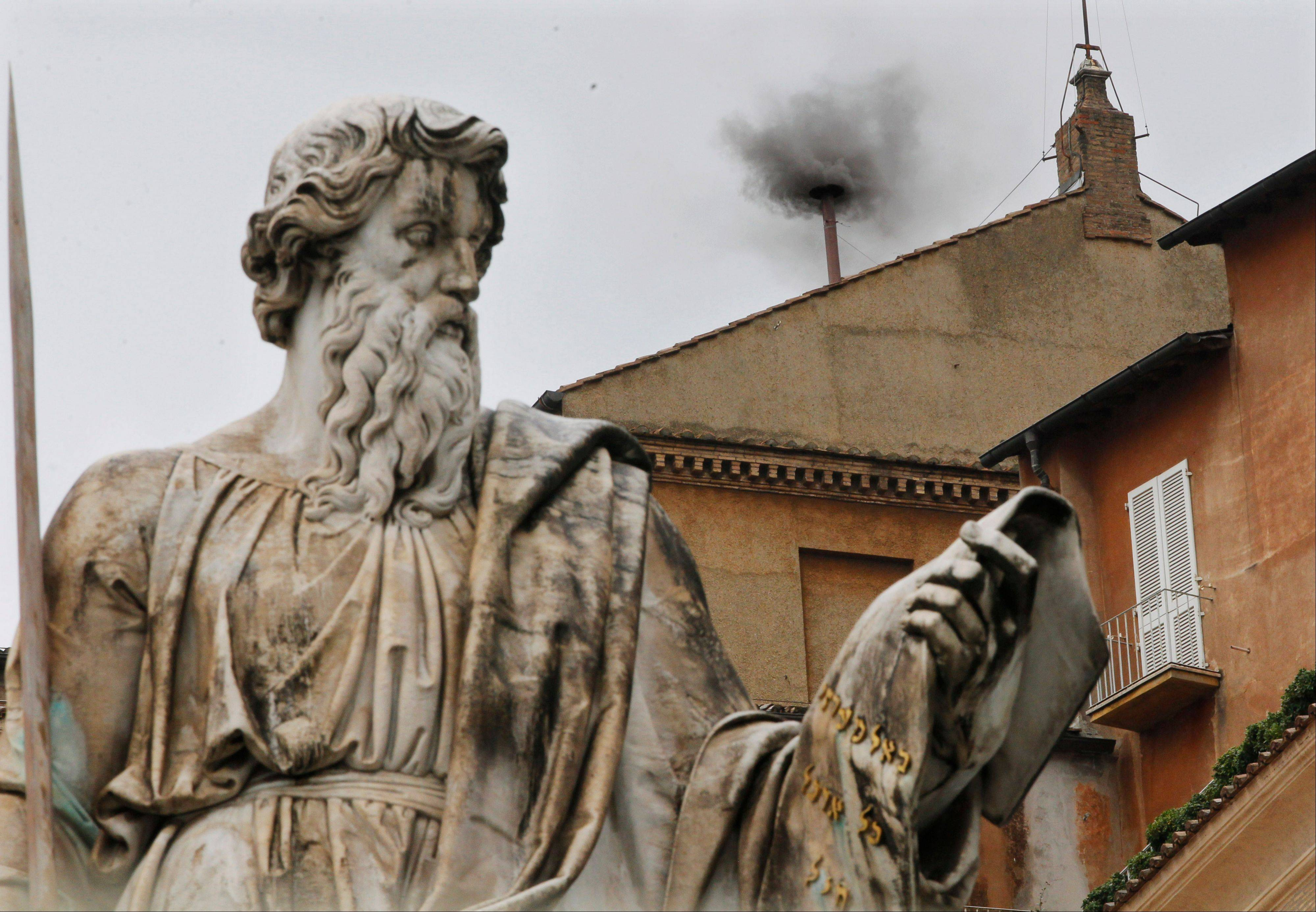Black smoke emerges from the chimney on the Sistine Chapel as cardinals voted on the second day of the conclave to elect a pope in St. Peter's Square at the Vatican, Wednesday.
