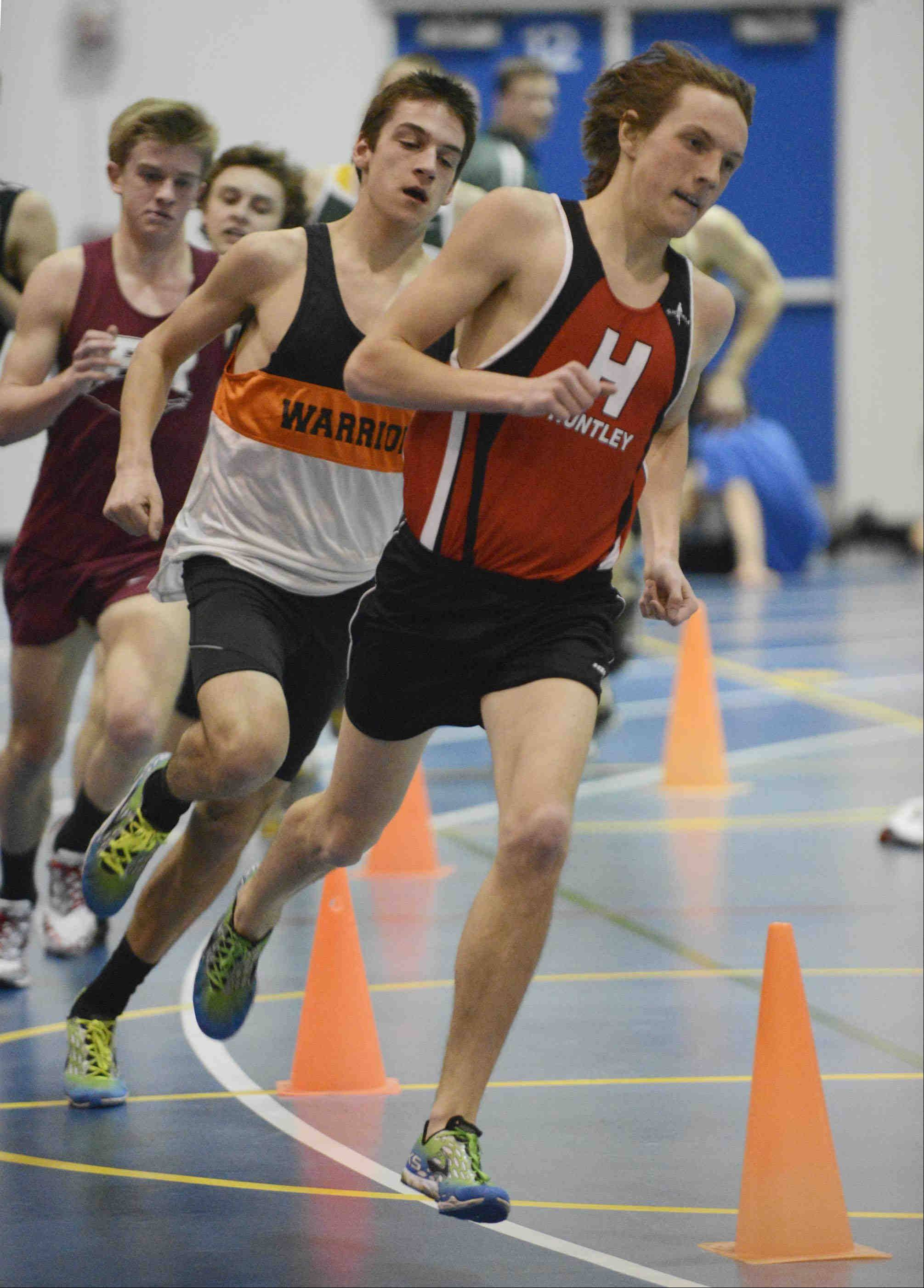 Huntley's Mark Marcuccelli leads his heat of the 1,600-meter run Wednesday at the Fox Valley Conference indoor meet at Dundee-Crown.