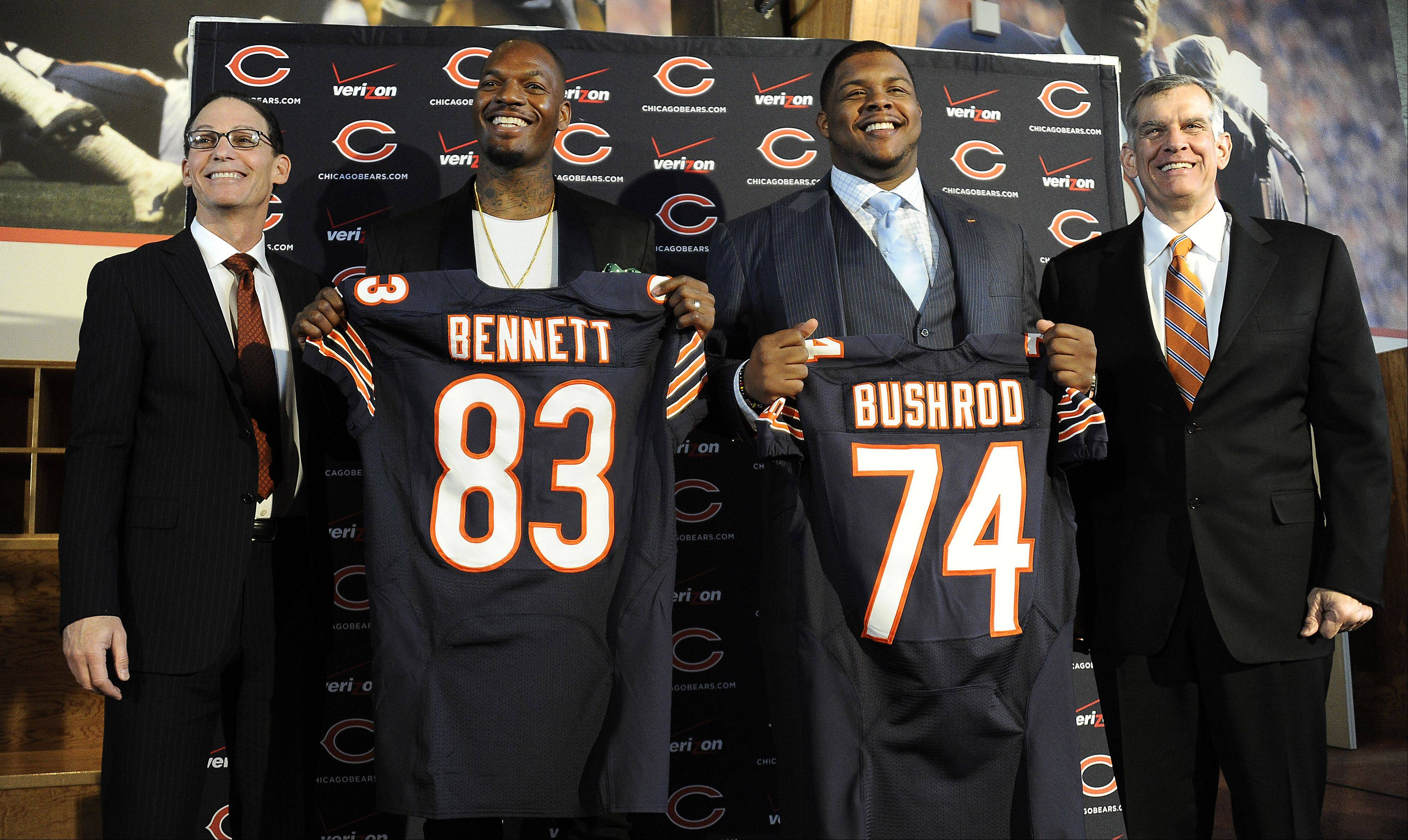 Bears coach Marc Trestman along with tight end Martellus Bennett and offensive tackle Jermon Bushrod and Bears General Manager Phil Emery stand with their new players introduced at the Walter Payton Center in Lake Forest on Wednesday.