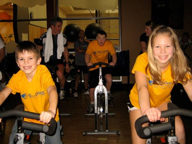 Brooke Wilkinson of Arlington Heights pedals alongside her cousin, Kyle Nowak (right)while her brother, Brett (center) keeps up the pace during the 2nd annual UPS for DownS Spin-A-Thon hosted at Midtown Athletic Club in Palatine on March 3.