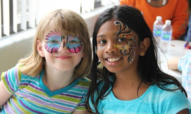 Children with painted faces learn about different cultures at last year's Garden of Diversity.