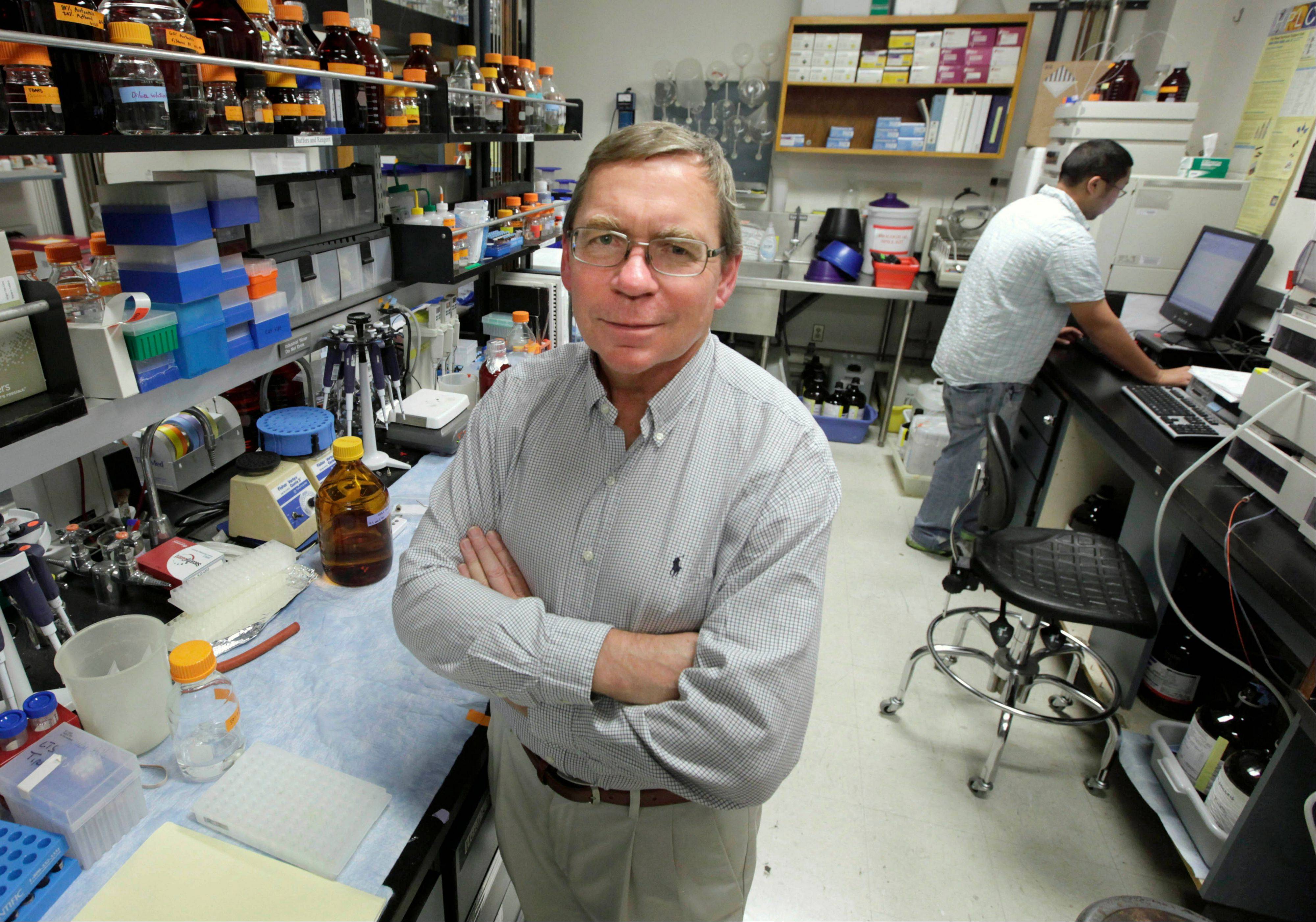 Carl Keen, who serves as chairman of the developmental nutrition program at the University of California, Davis, poses in one of the schools laboratories in Davis, Calif. Keen, whose position is funded by the candy giant, Mars Inc., said his laboratory�s findings have pushed science forward through establishing that nutrients in cocoa powder can lower heart disease risk.