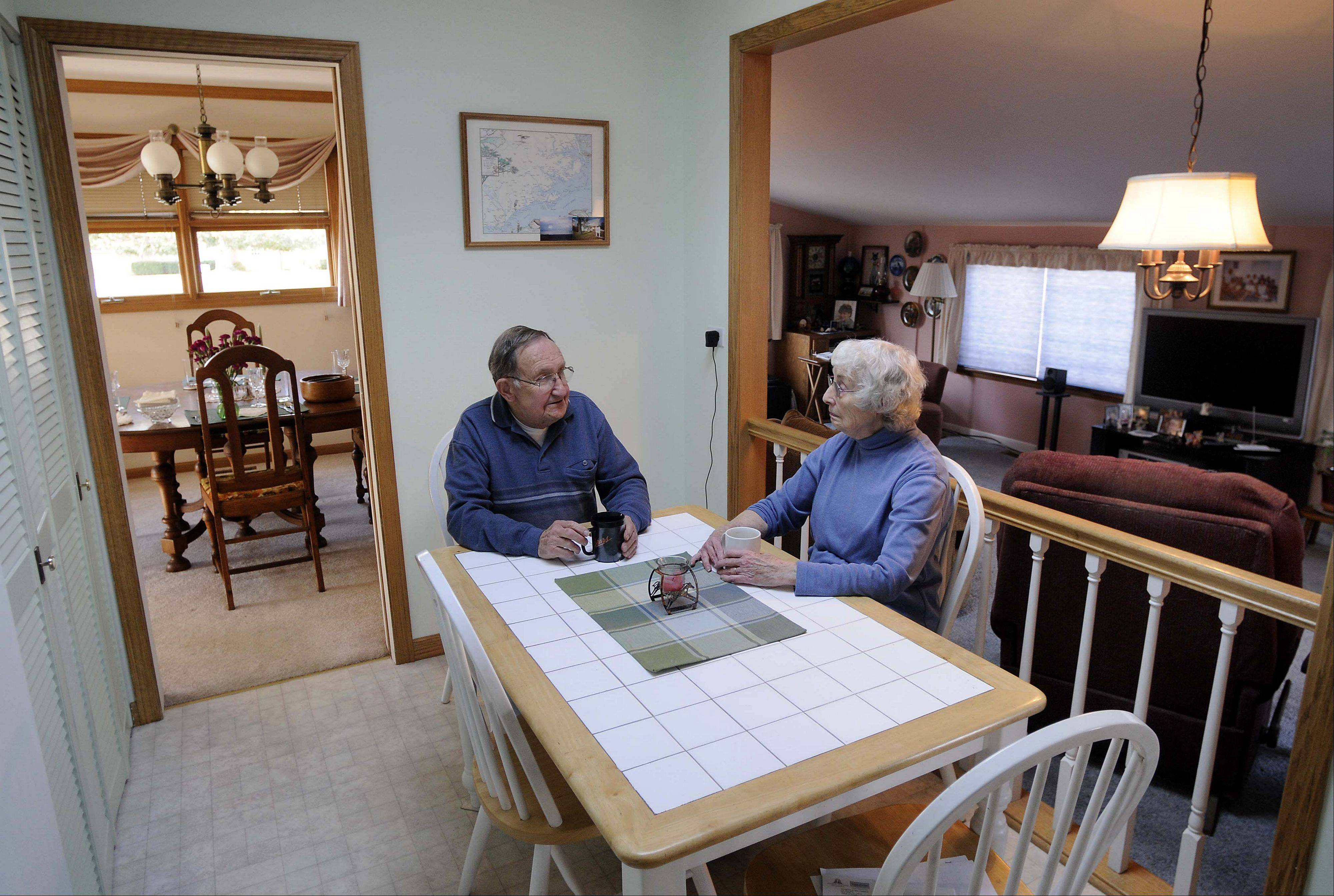 Bill and Martha Roberts sit at their kitchen table in 2008 with the family room, converted from a carport, in the background. They bought one of the first homes in Rolling Meadows for about $19,000 in 1962 at a time when Kimball Hill was putting 20 of them up a week.