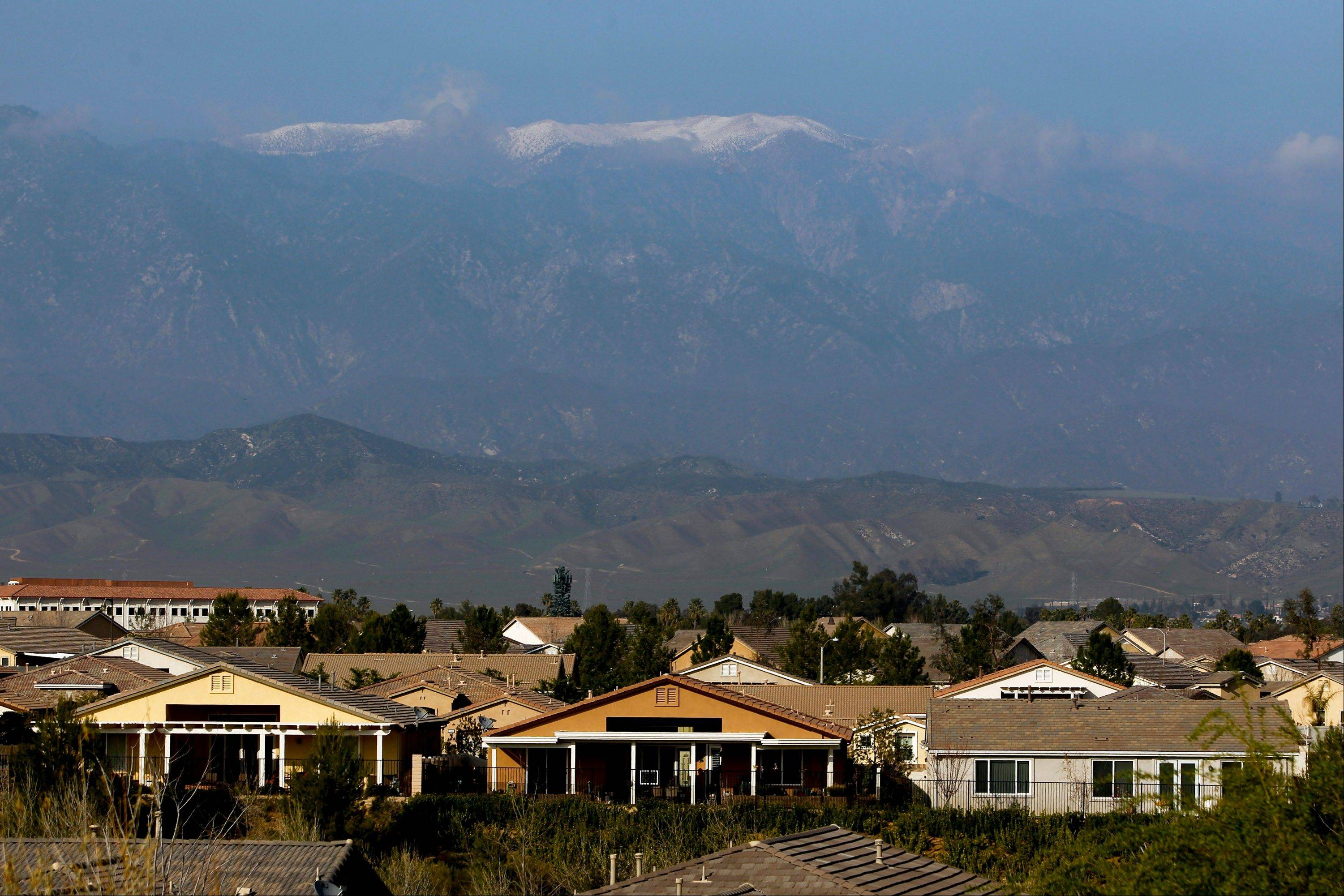 Snow-capped mountains stand on the horizon behind newly built homes at the Hovnanian Enterprises Inc.�s Four Seasons housing development in Beaumont, California.