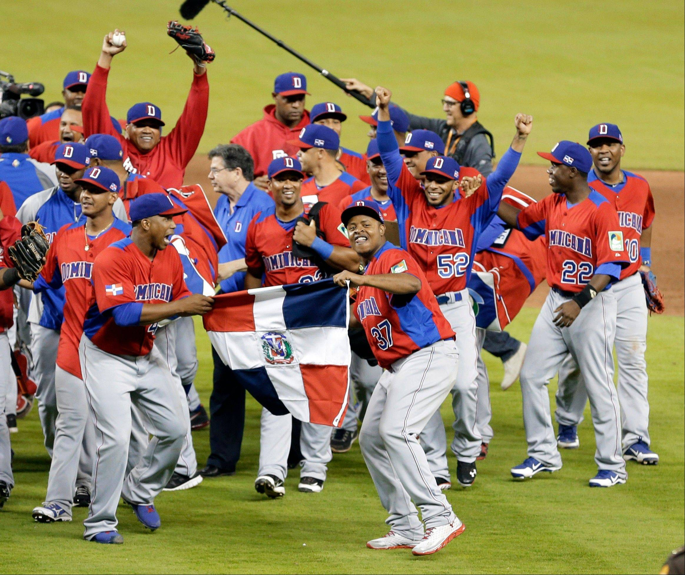 Dominican Republic players celebrate their 3-1 win over the United States during a second-round game of the World Baseball Classic in Miami, Thursday, March 14, 2013. (AP Photo/Alan Diaz)