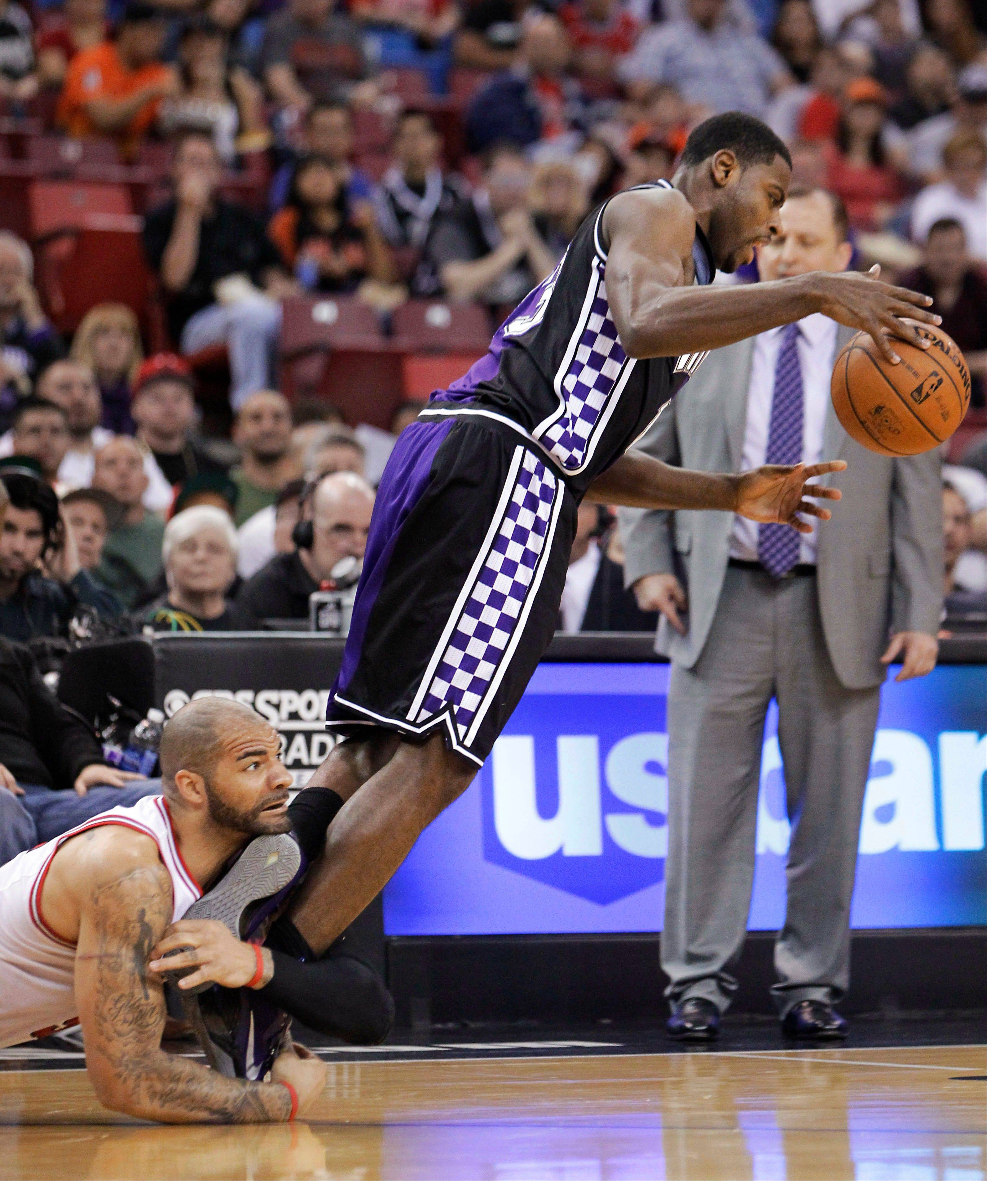 The Bulls� Carlos Boozer, left, fouls Kings guard Tyreke Evans.