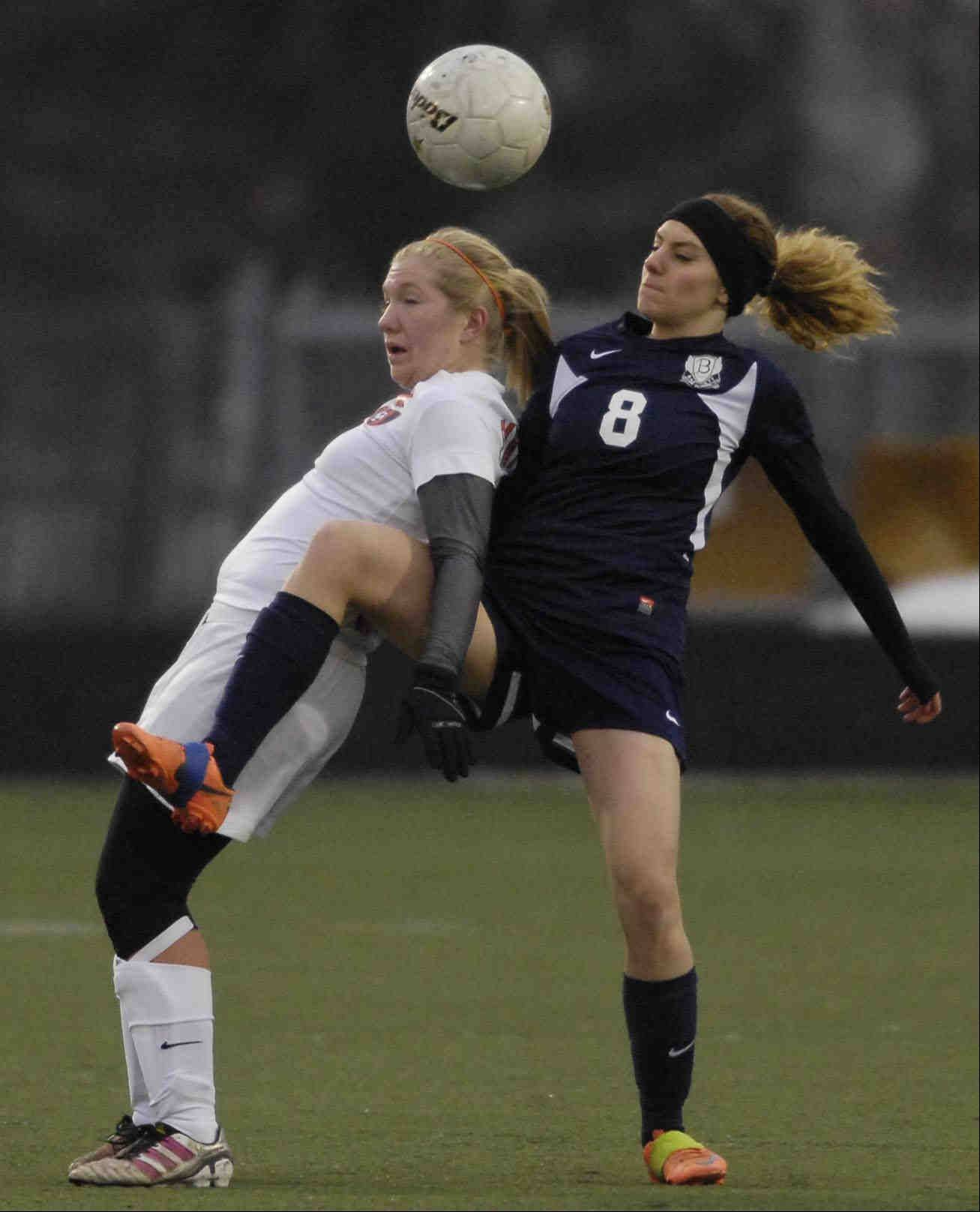 Bartlett's Lindsay Rockensock, right, and Oswego's Lisa Dano tangle as they compete for the soccer ball Thursday at Millennium Field in Streamwood.