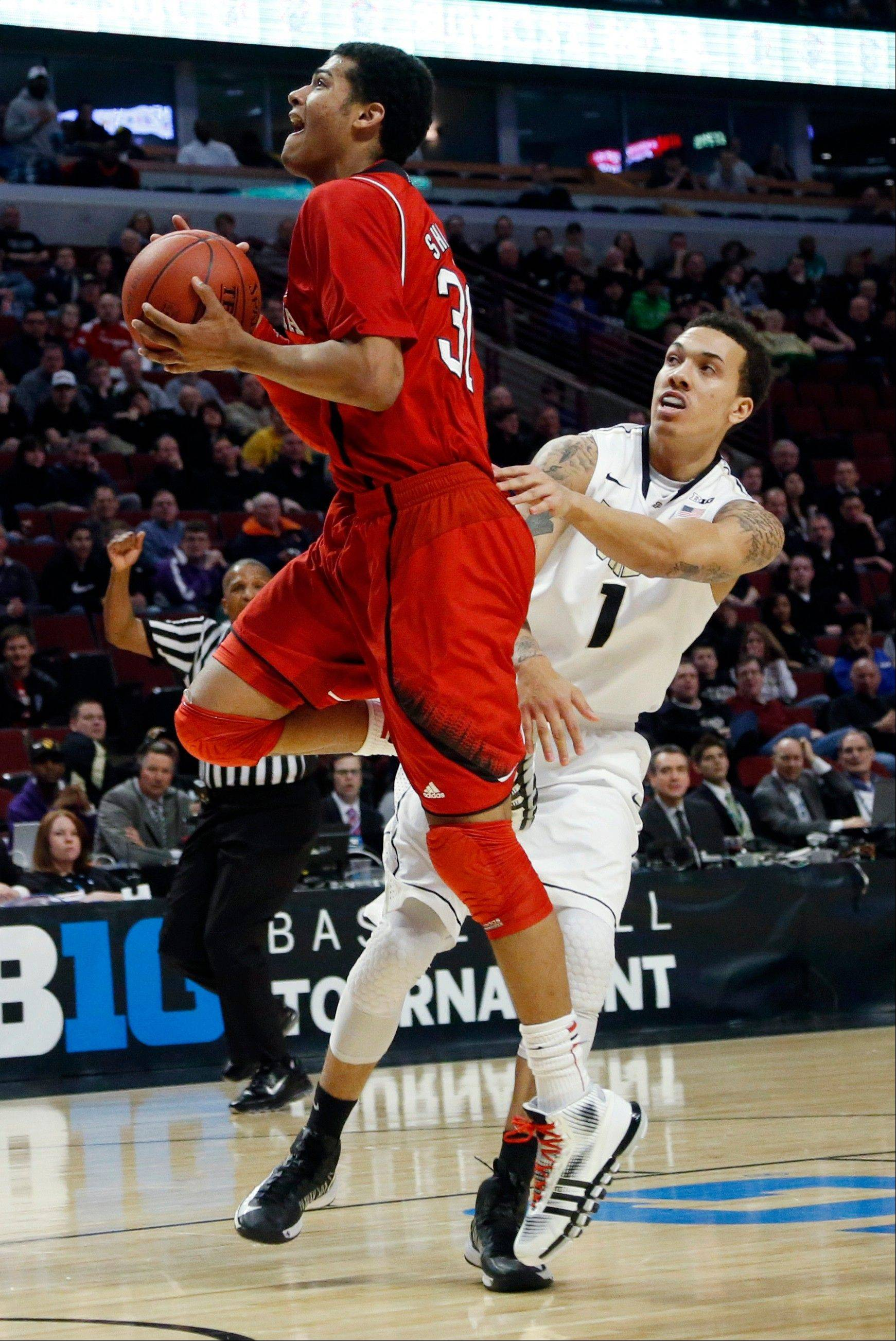 Nebraska's Shavon Shields drives past Purdue's Anthony Johnson (1) during the first half of an NCAA college basketball game at the Big Ten tournament Thursday, March 14, 2013, in Chicago. (AP Photo/Charles Rex Arbogast)