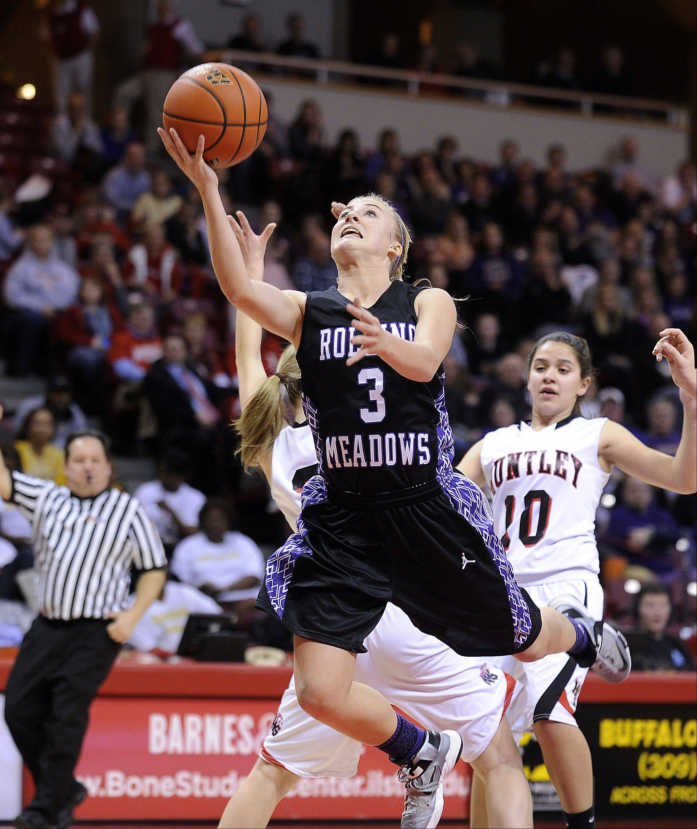 Rolling Meadows junior guard Jackie Kemph, here getting to the basket in the Mustangs� Class 4A state semifinal victory in Normal, has been named Gatorade�s Illinois girls basketball player of the year.