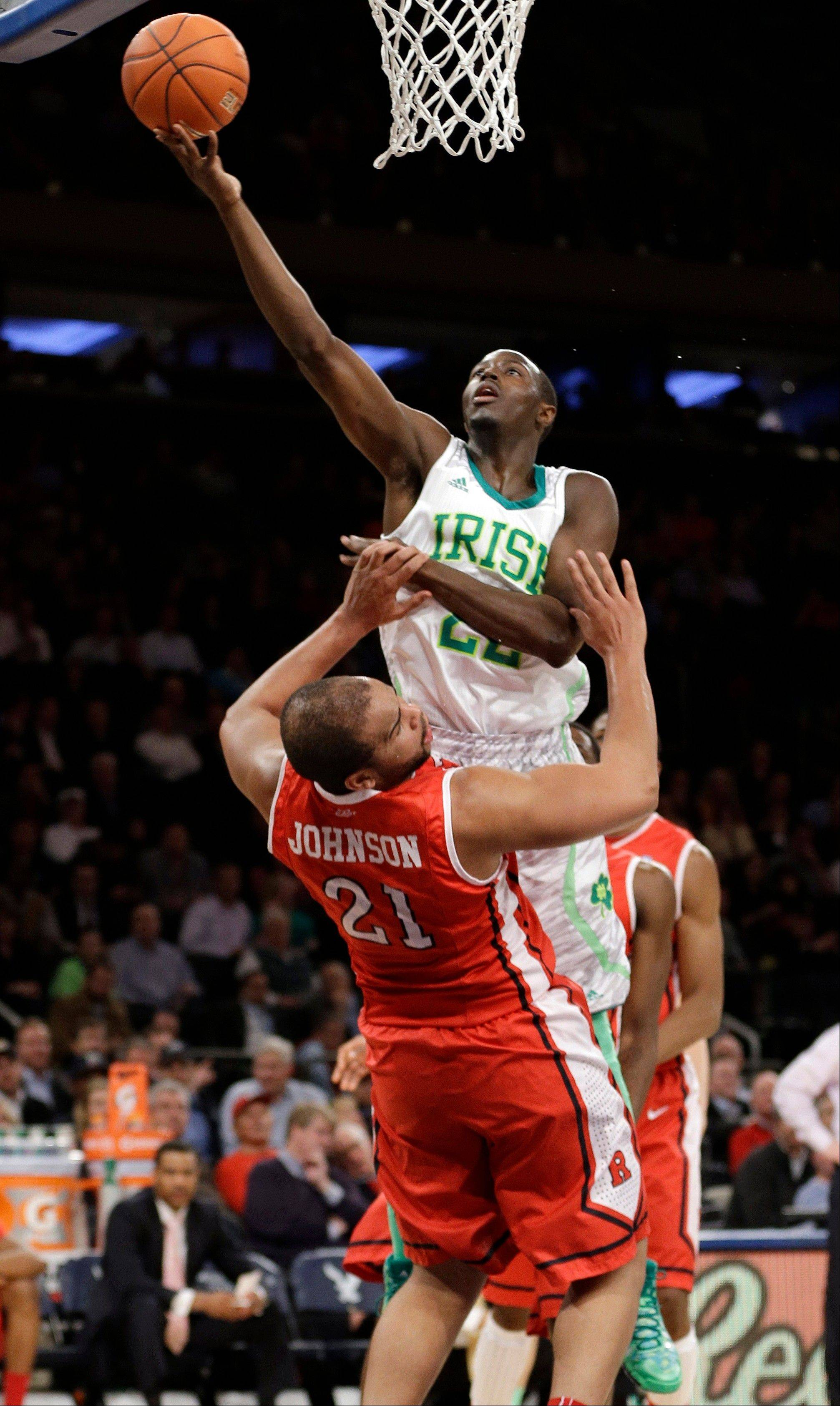 Rutgers� Austin Johnson (21) draws a foul as Notre Dame�s Jerian Grant (22) attempts to score Wednesday night in New York. Notre Dame beat Rutgers 69-61 in Big East tourney play.