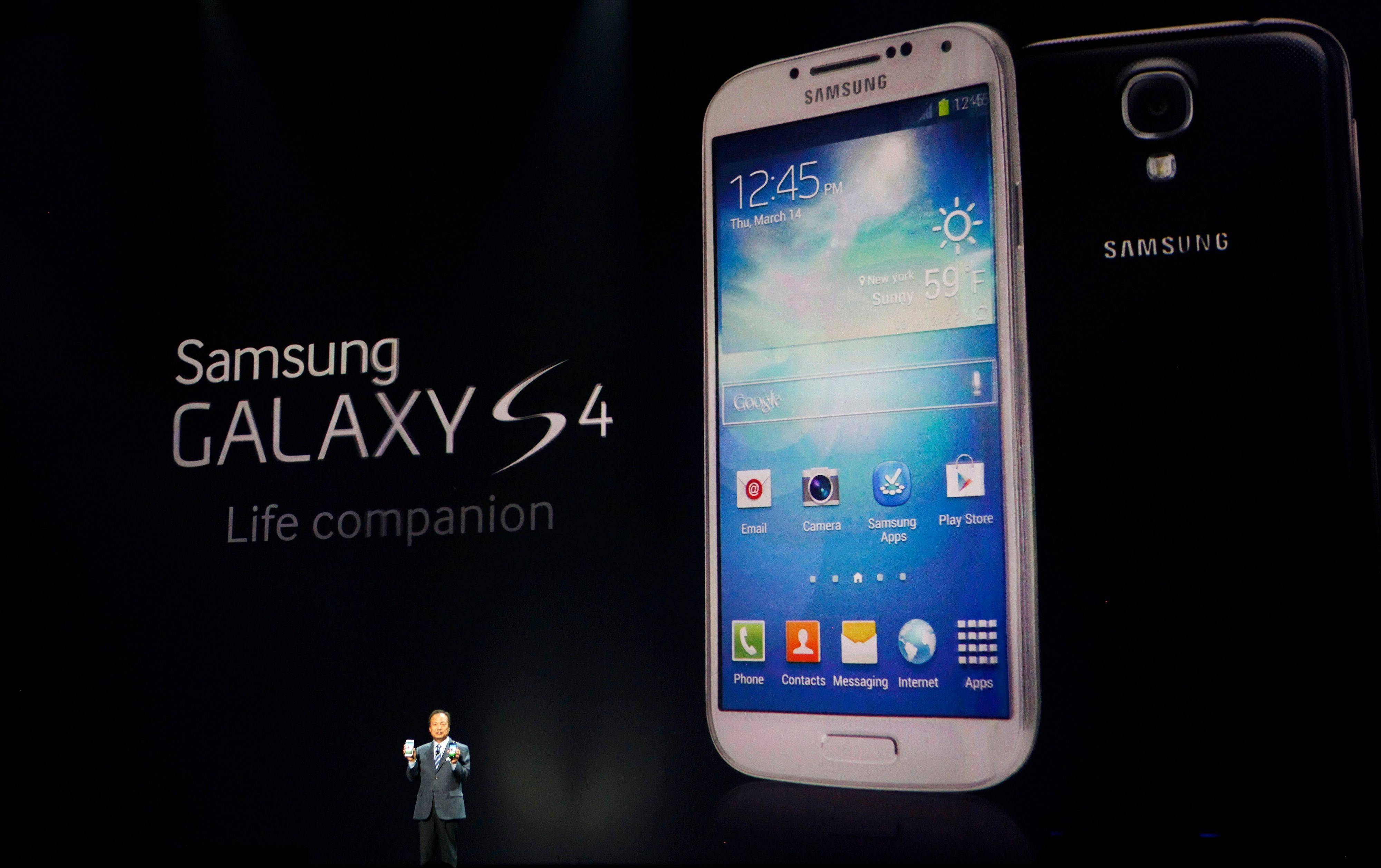 JK Shin, president and head of IT and mobile communications for Samsung Electronics, presents the new Samsung Galaxy S 4 during the Samsung Unpacked event in New York Thursday.