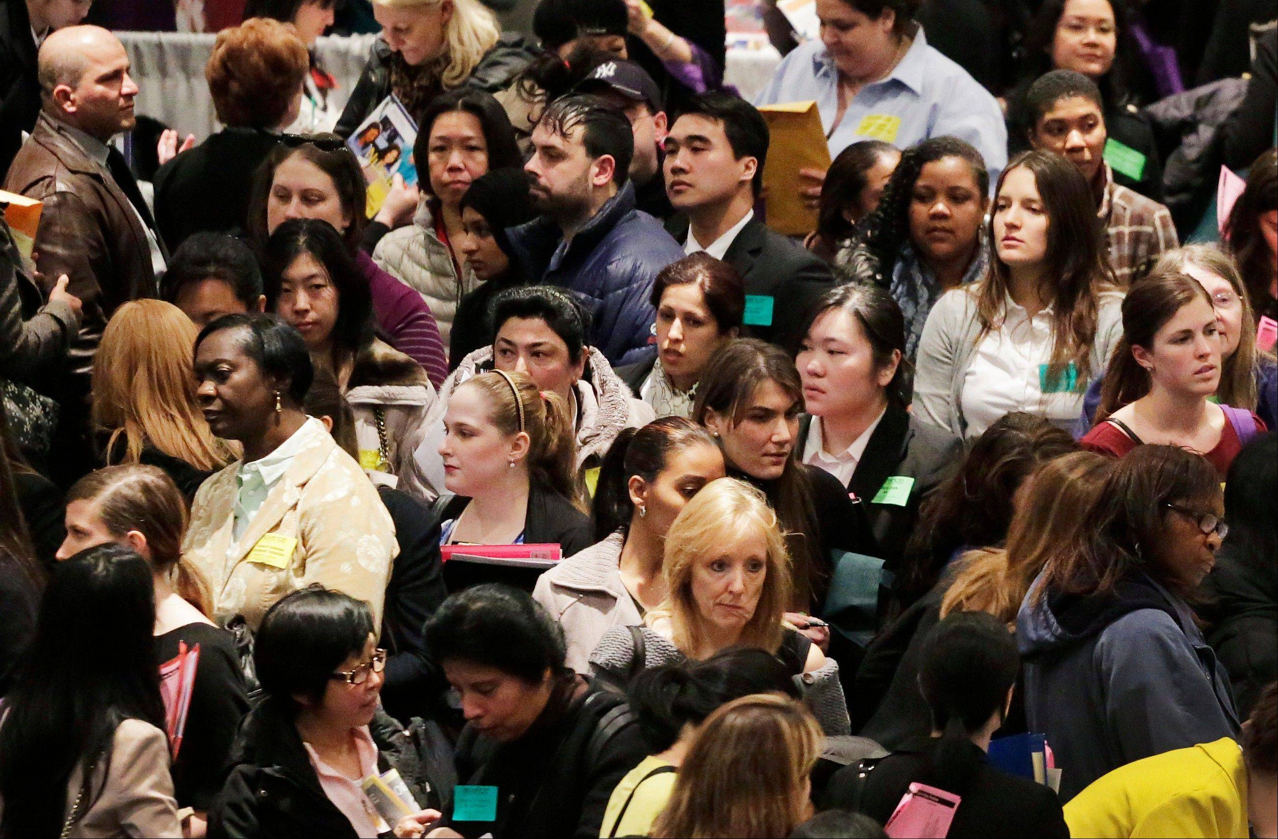 A crowd of job seekers attends a health care job fair, Thursday in New York.