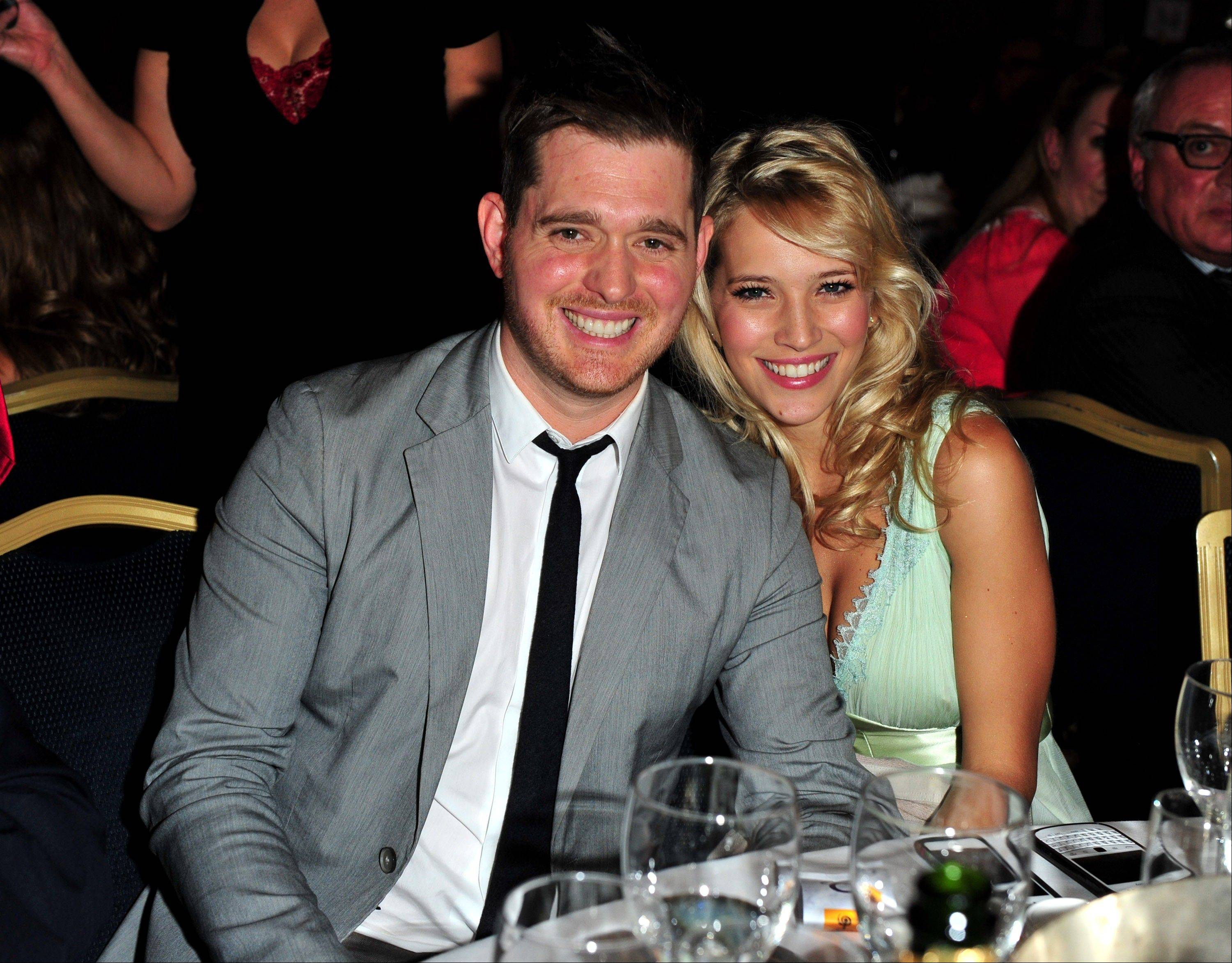 Singer Michael Buble and his wife, Argentine TV actress Luisana Lopilato, are their expecting their first child.