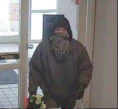 A man wearing a black and gray scarf covering most of his face robbed a bank Thursday morning in Winfield, authorities said.