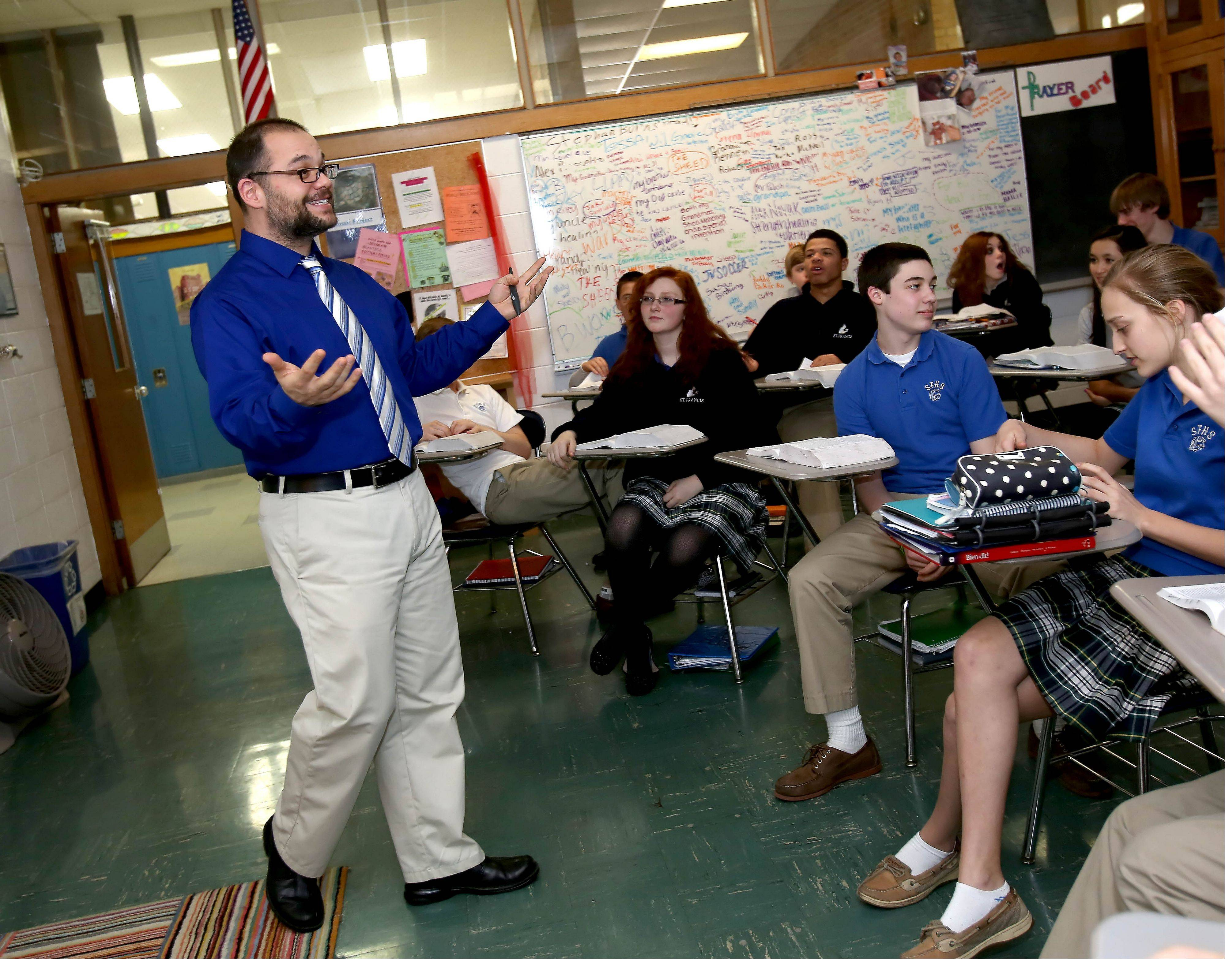 Michael Page teaches freshmen in religion class at St. Francis High School in Wheaton. Students at the school are thrilled the new pope has named himself after St. Francis of Assisi.
