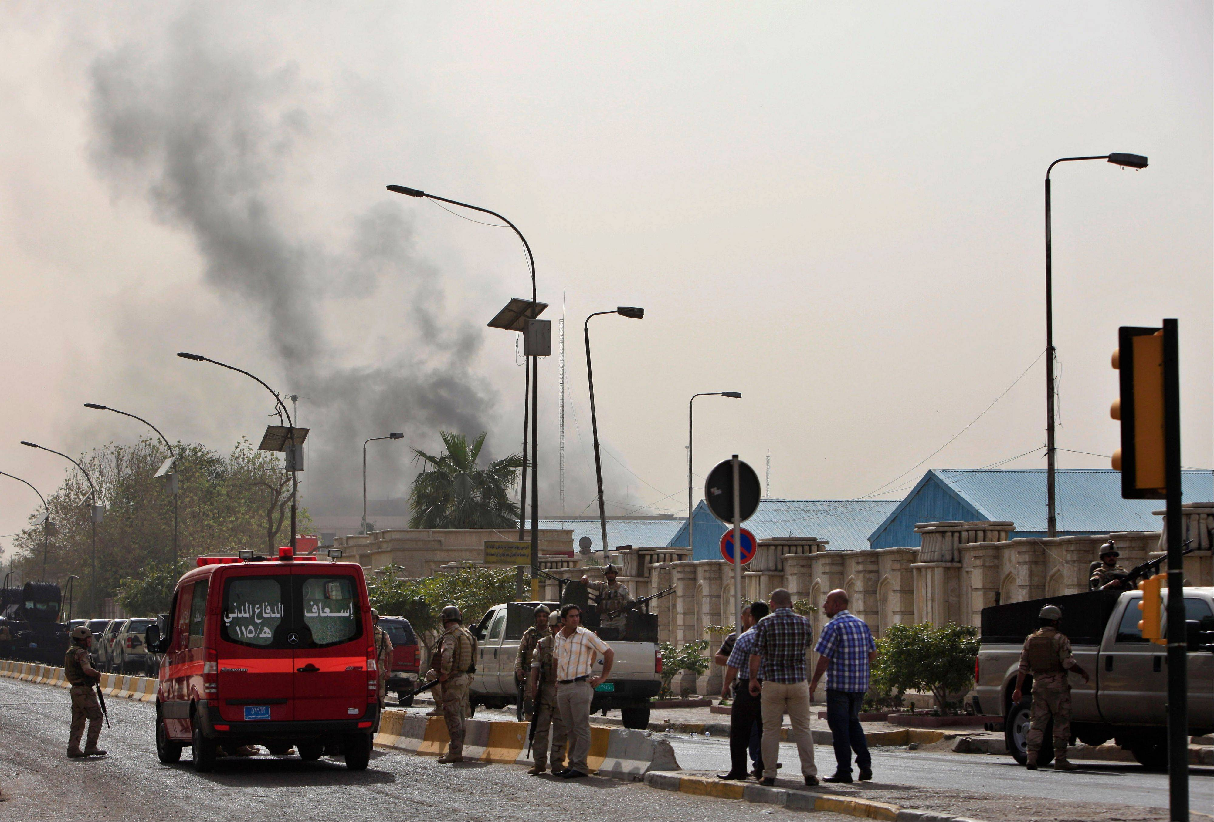 Black smoke from a car bomb attack is seen in Baghdad, Iraq, Thursday, March, 14, 2013. A string of explosions tore through central Baghdad within minutes of each other on Thursday, followed by what appeared to be a coordinated assault by gunmen who battled security forces in the Iraqi capital, according to officials.