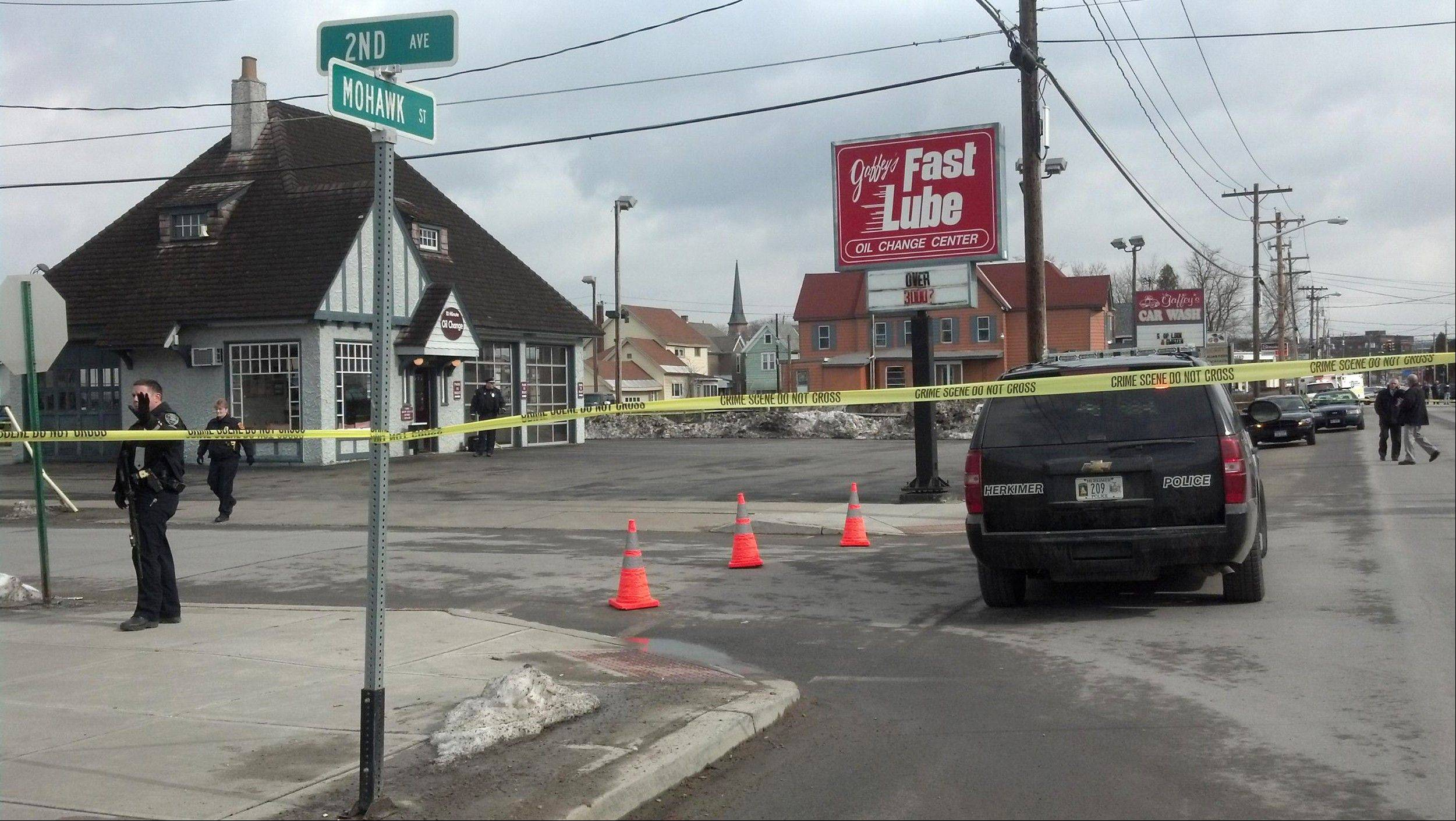 Shootings at two different businesses in the village of Herkimer, N.Y., left four people dead and at least two wounded, according to police, Wednesday, March 13, 2013.