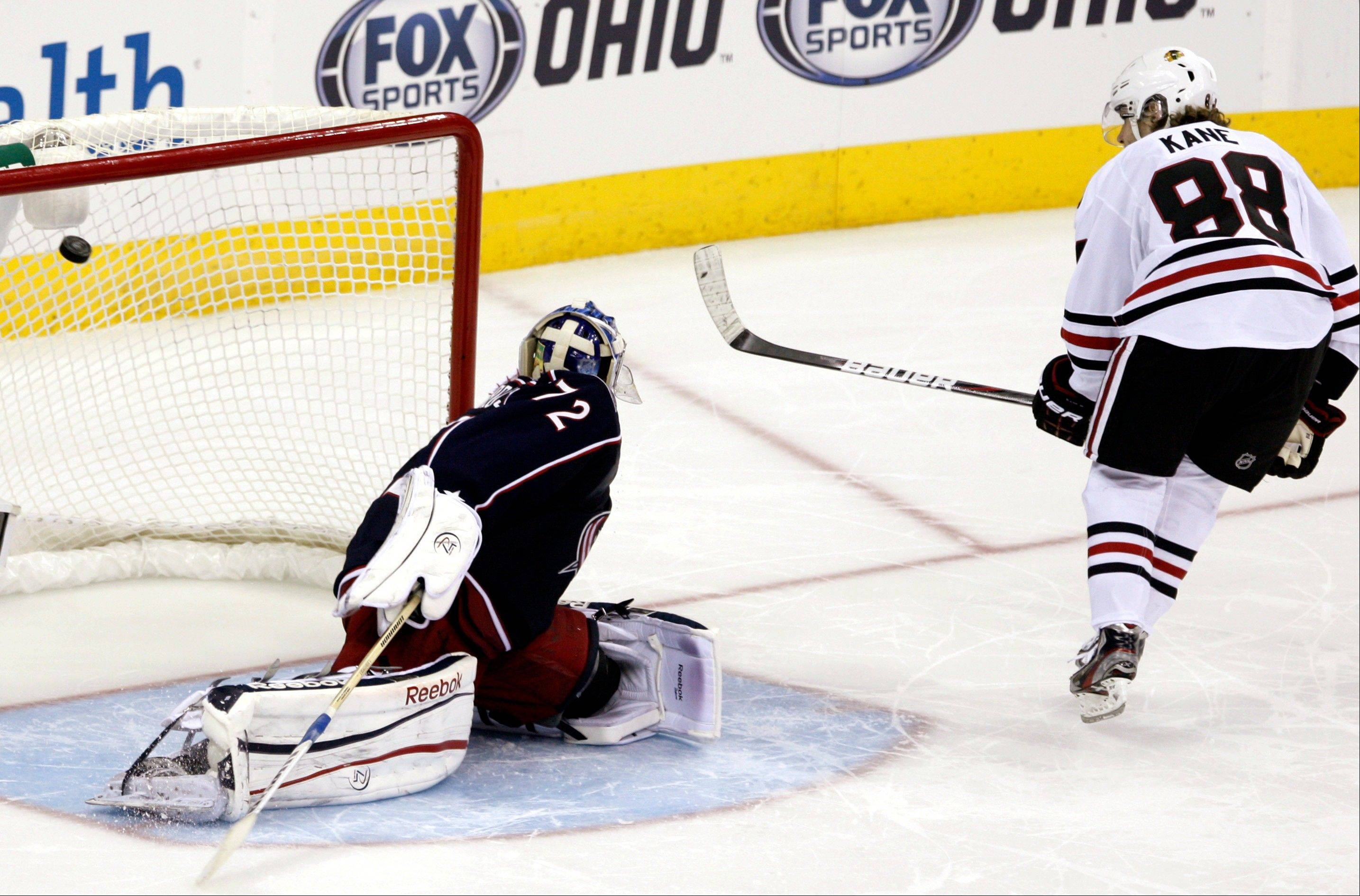 Patrick Kane scores against Columbus Blue Jackets' Sergi Bobrovsky, of Russia, in the shootout in Columbus, Ohio, Thursday, March 14, 2013. The Blackhawks won 2-1.