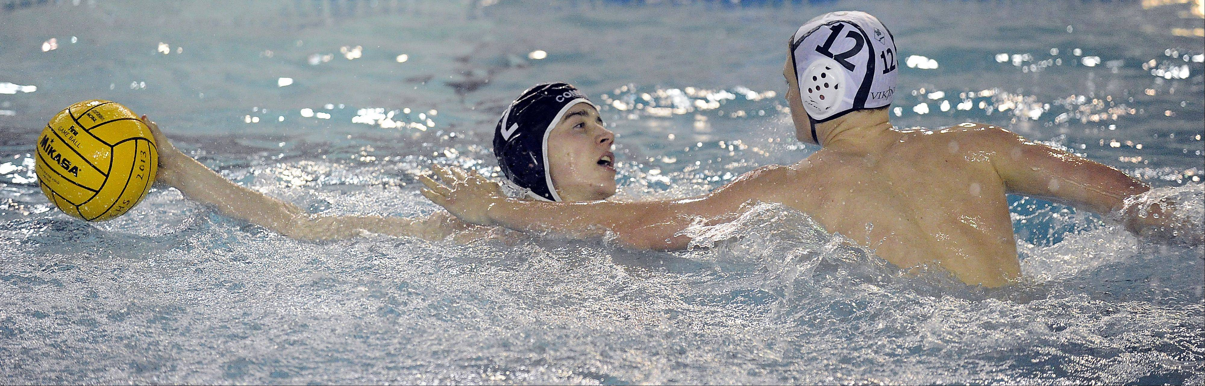Fremd's Luke Stark defends against Conant's Jon Burke during the Vikings' MSL West victory Thursday.