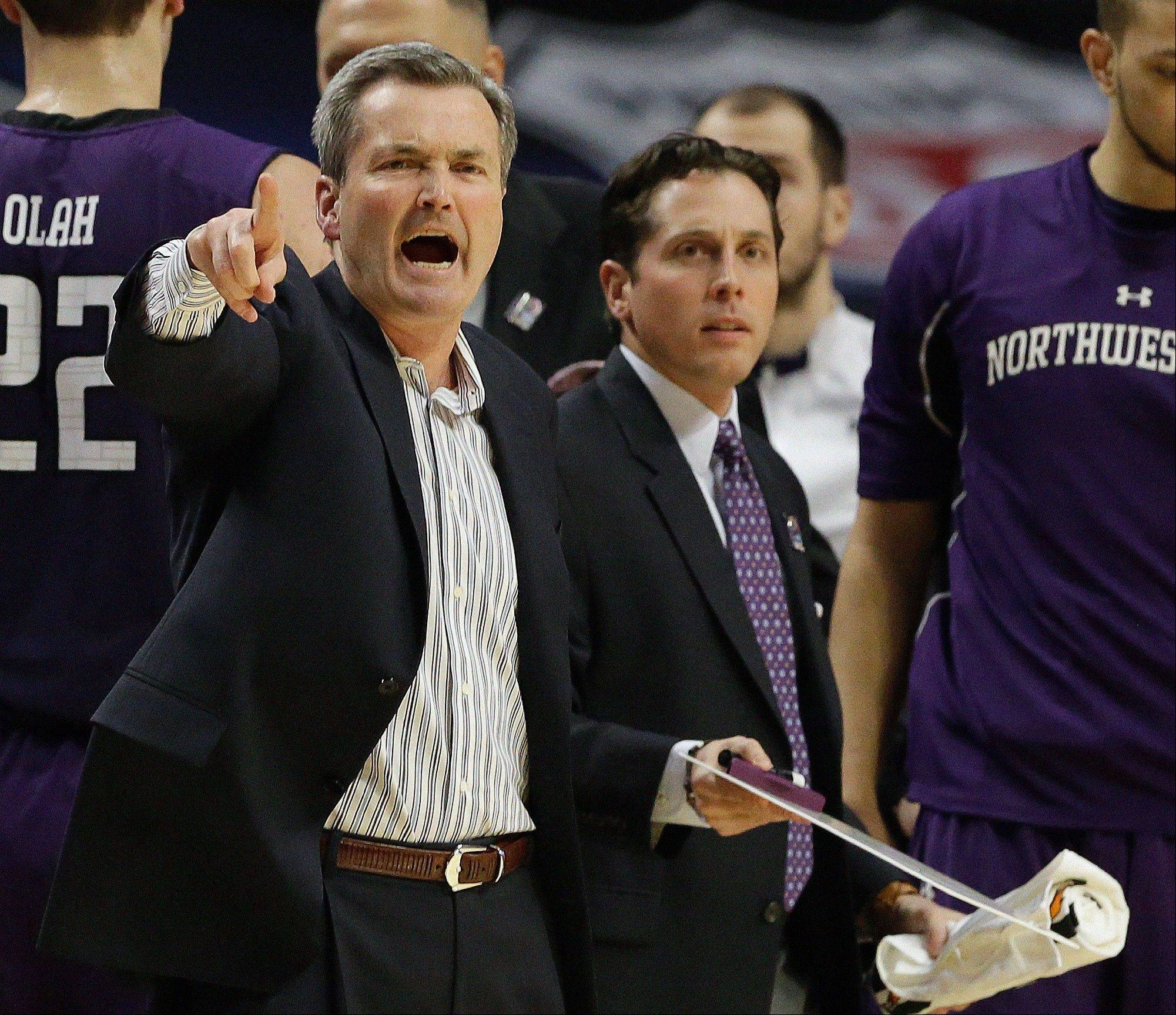 Northwestern head coach Bill Carmody reacts to a call during the first half.