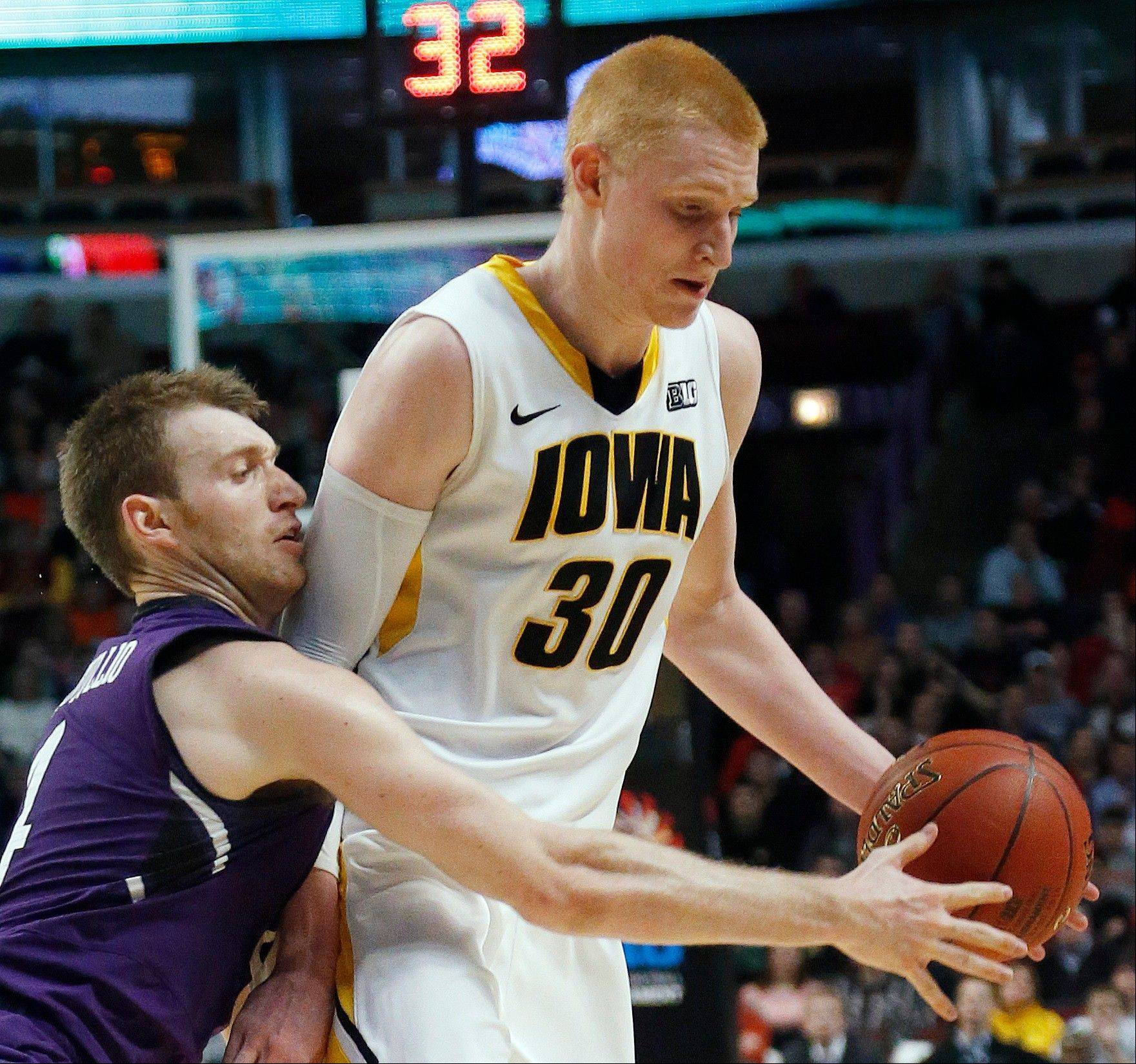 Northwestern's Alex Marcotullio tries to steal the ball from Iowa's Aaron White (30) during the first half.