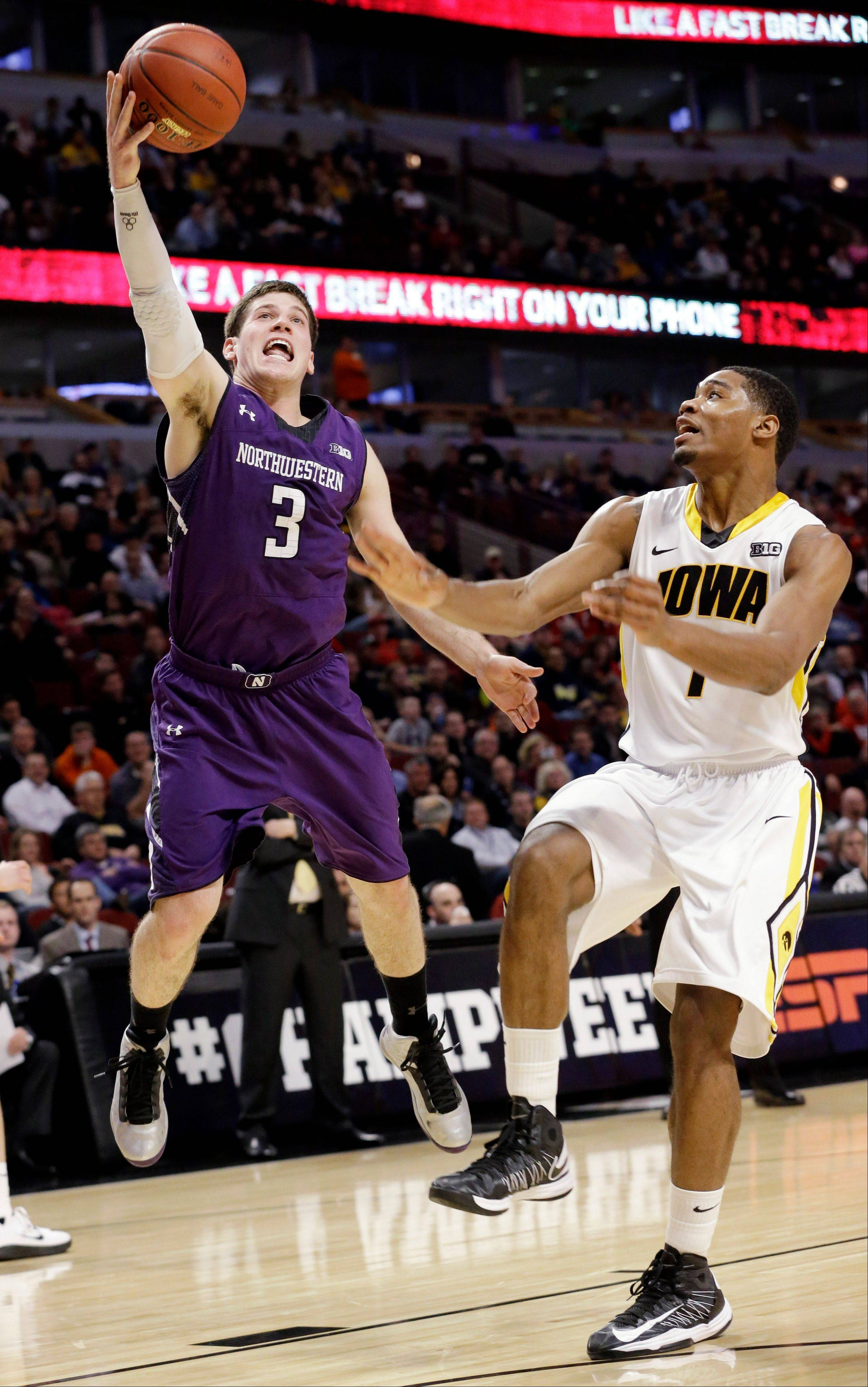 Northwestern's Dave Sobolewski shoots past Iowa's Melsahn Basabe during the first half.