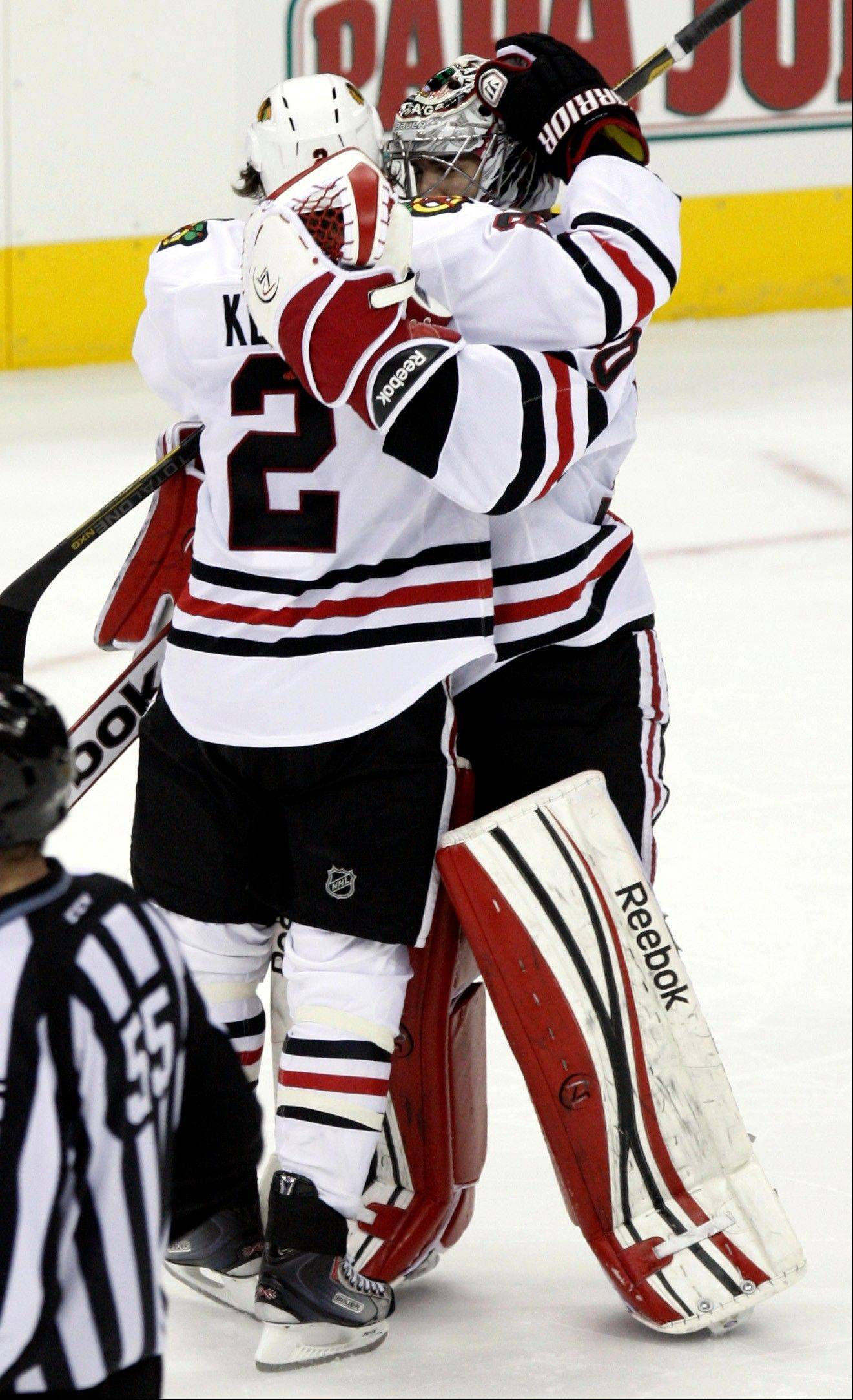 Chicago Blackhawks' Duncan Keith, left, celebrates with goalie Corey Crawford following the Blackhawks' 2-1 win over the Columbus Blue Jackets in a shootout.