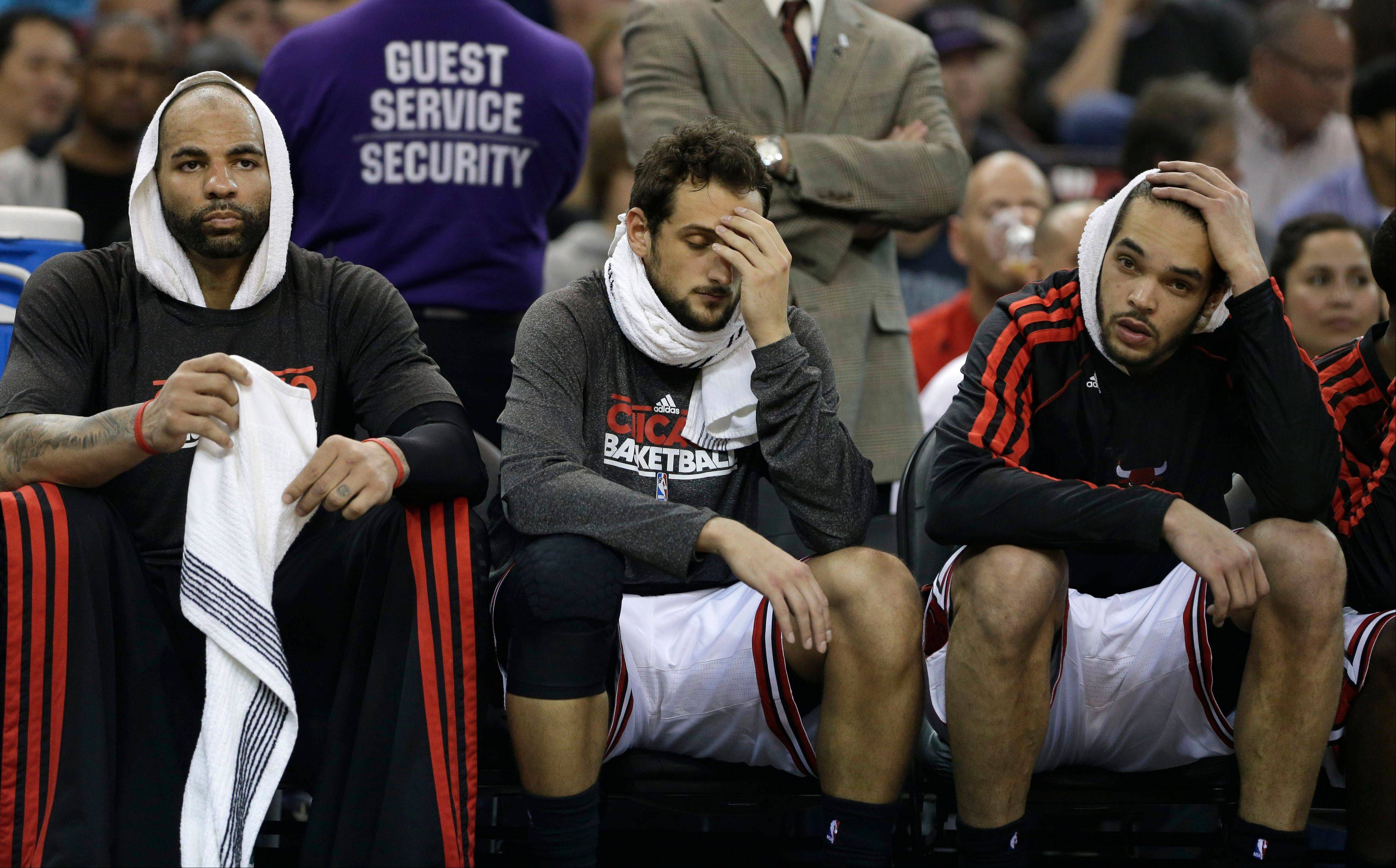 Carlos Boozer, left, Marco Belinelli and Joakim Noah watch the closing moments of the Bulls' 121-79 loss to Kings in Sacramento on Wednesday.