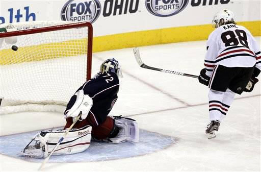 Patrick Kane, right, scores the game-winning goal against Columbus Blue Jackets' Sergi Bobrovsky Thursday in Columbus.