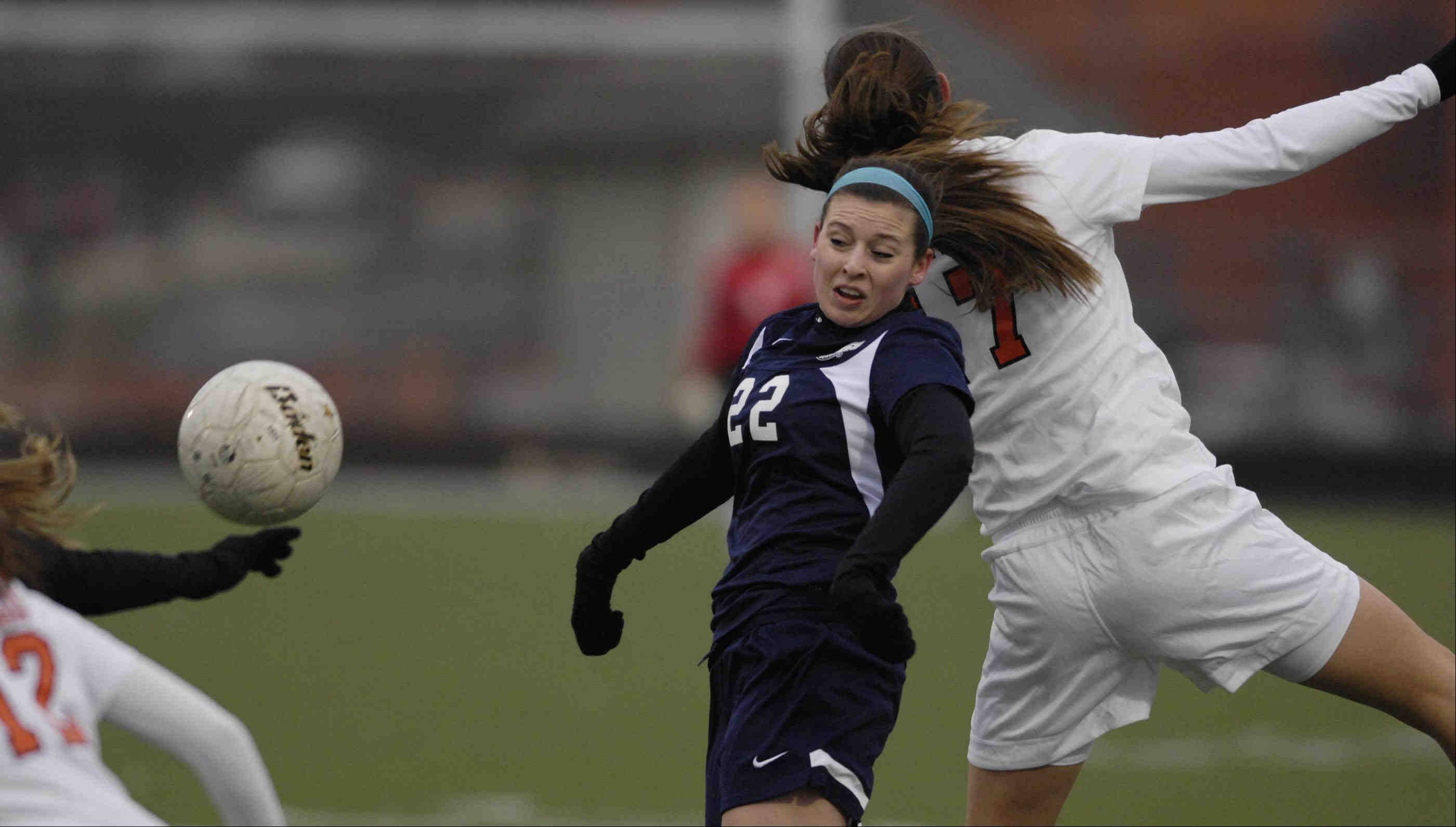 Bartlett's Shannon Brohan holds off Oswego's Kaylan Mills Thursday at Millennium Field in Streamwood.