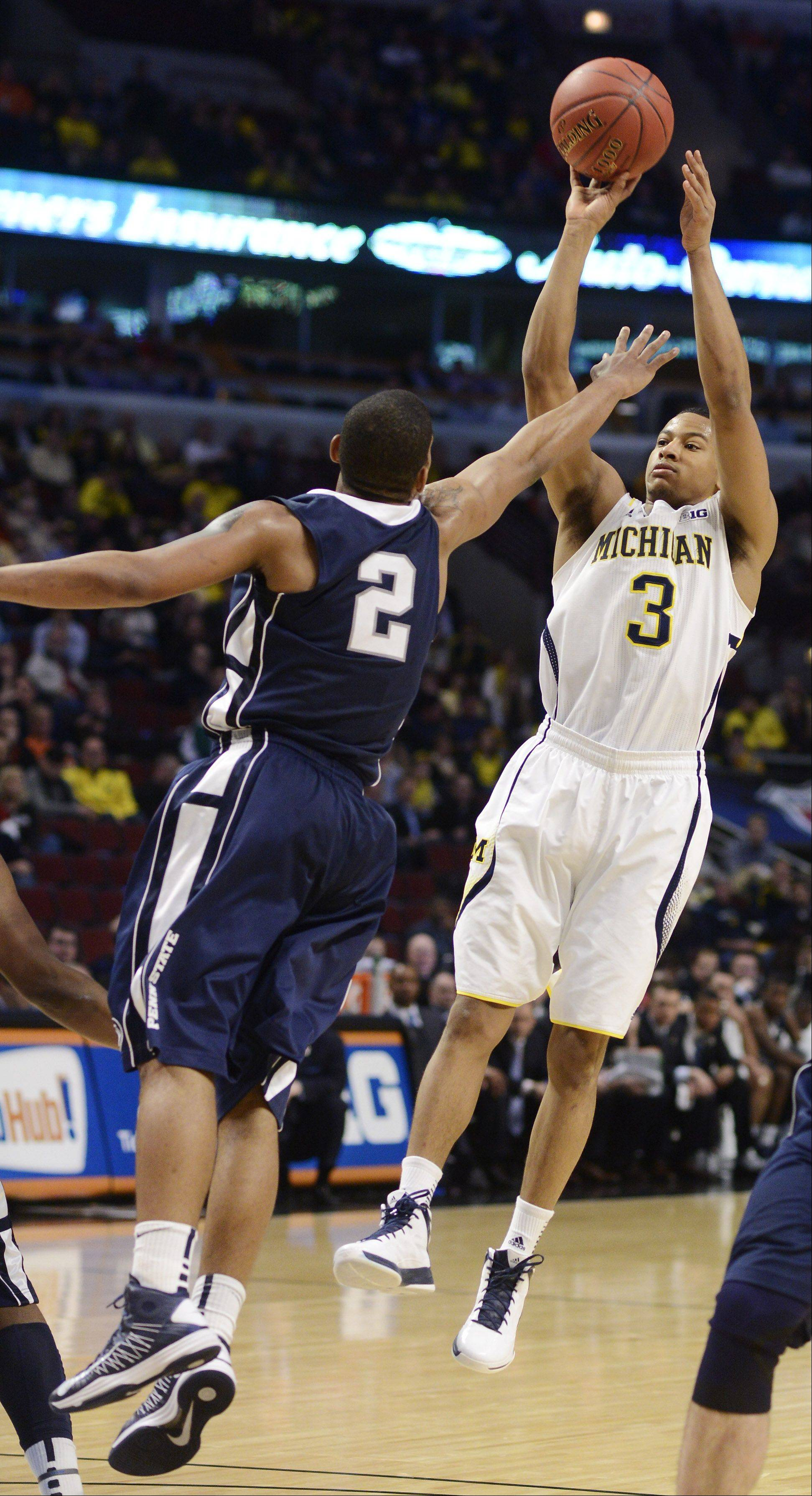 Michigan's Trey Burke takes a shot in front of Penn State's D.J. Newbill.