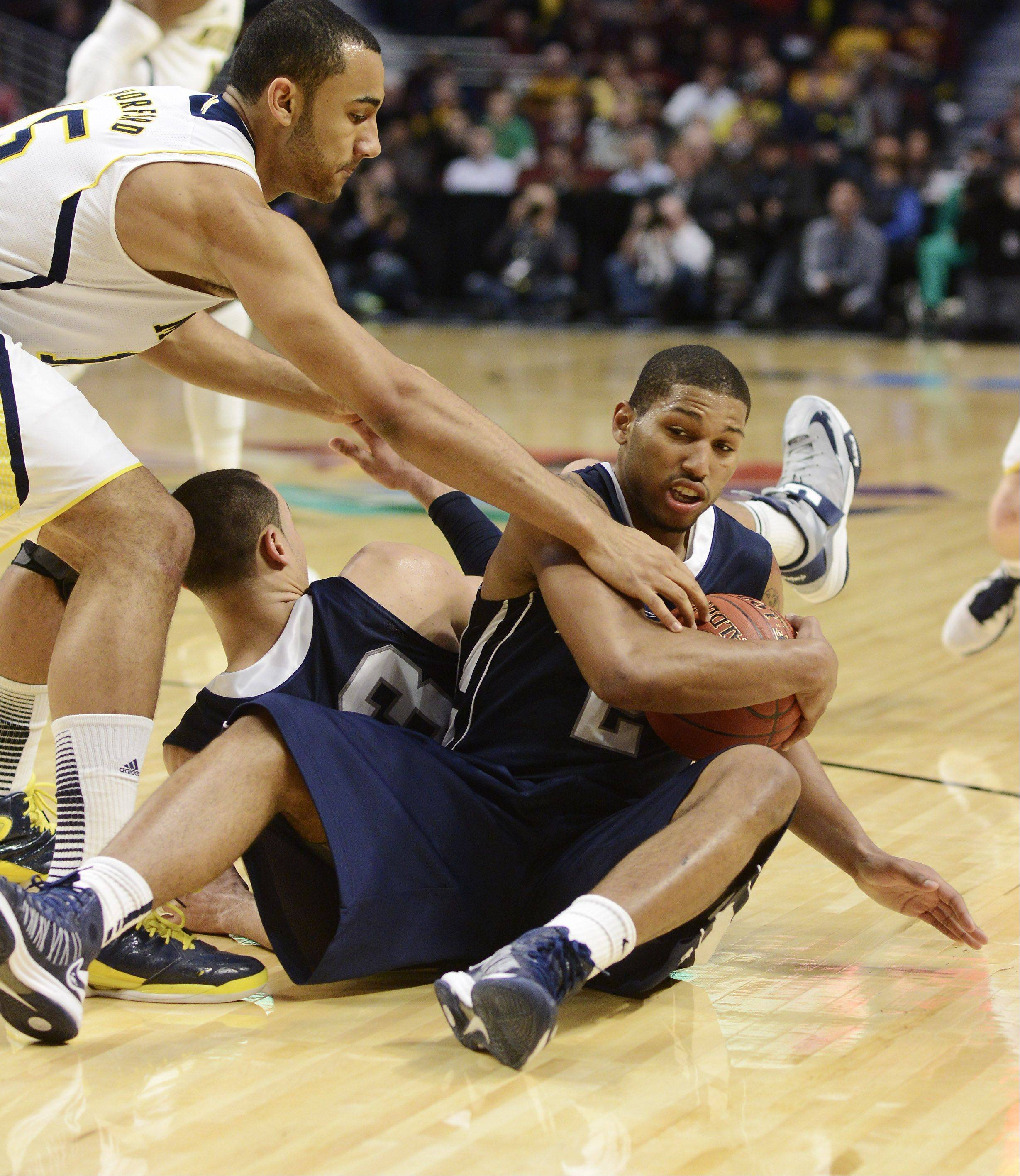 Penn State's D.J. Newbill tries to keep the ball from Michigan's Jon Horford .