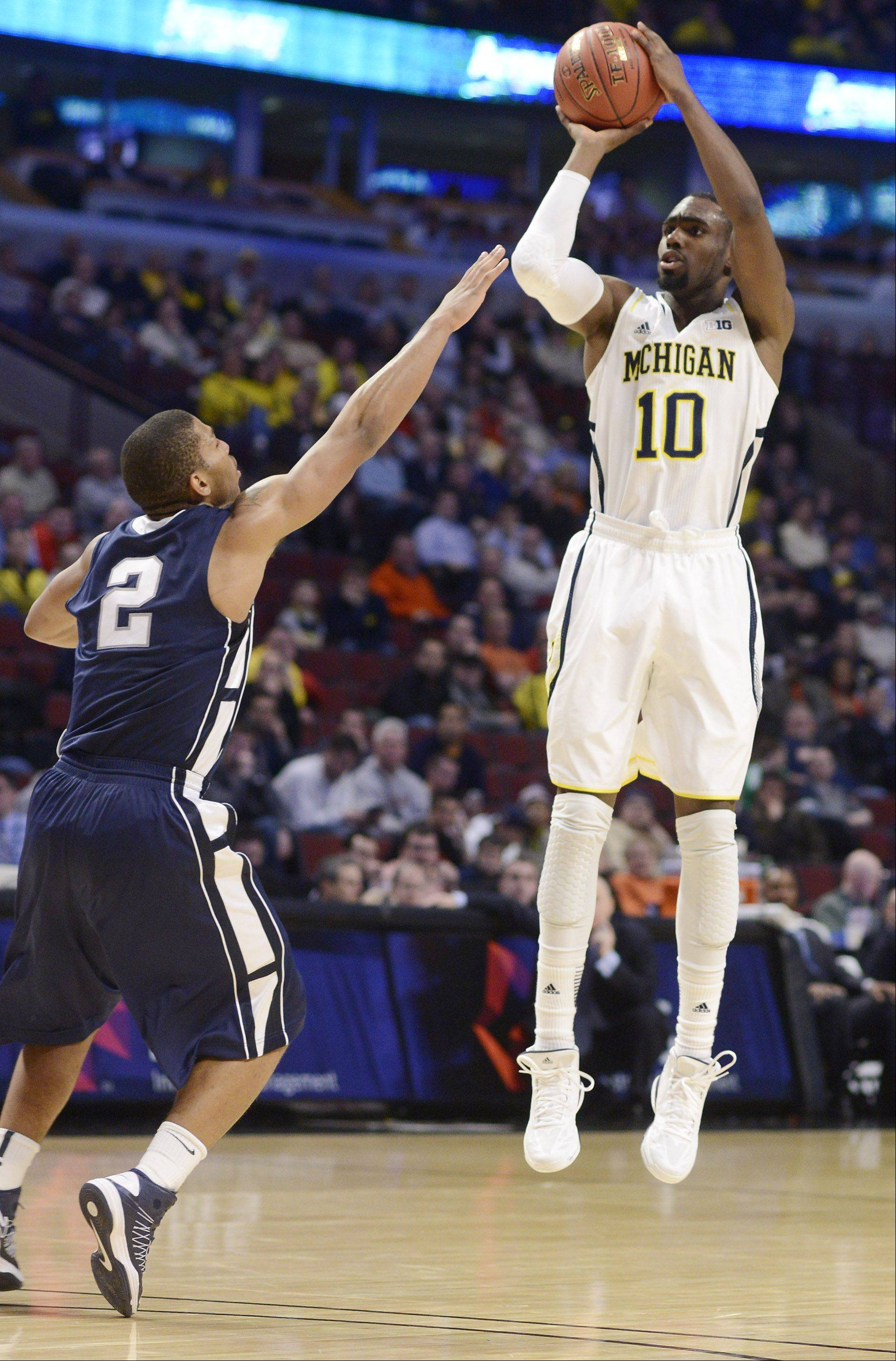 Michigan's Tim Hardaway Jr. takes a shot against Penn State defender D. J. Newbill.