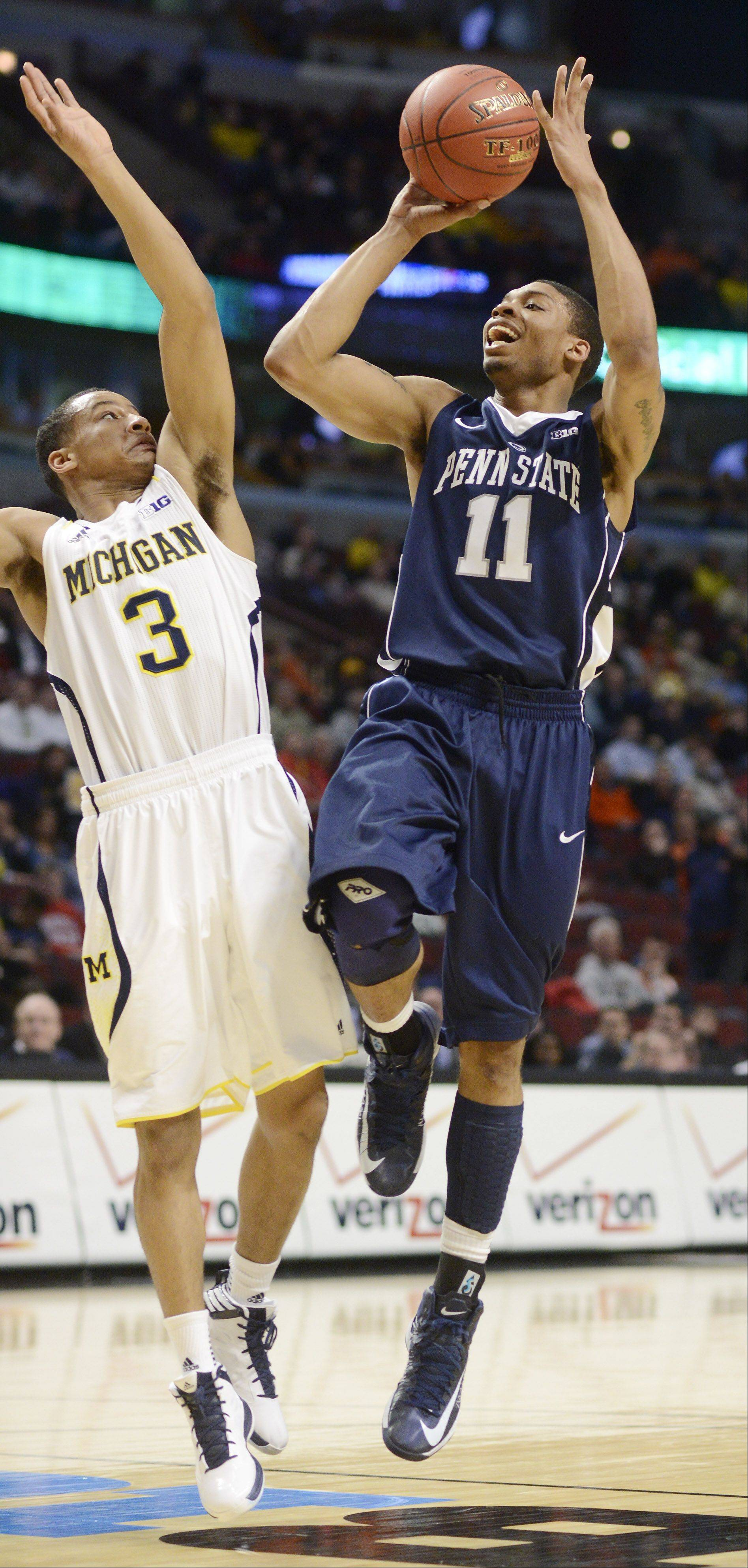 Penn State's Jermaine Marshall takes a shot against the defense of Michigan's Trey Burke.