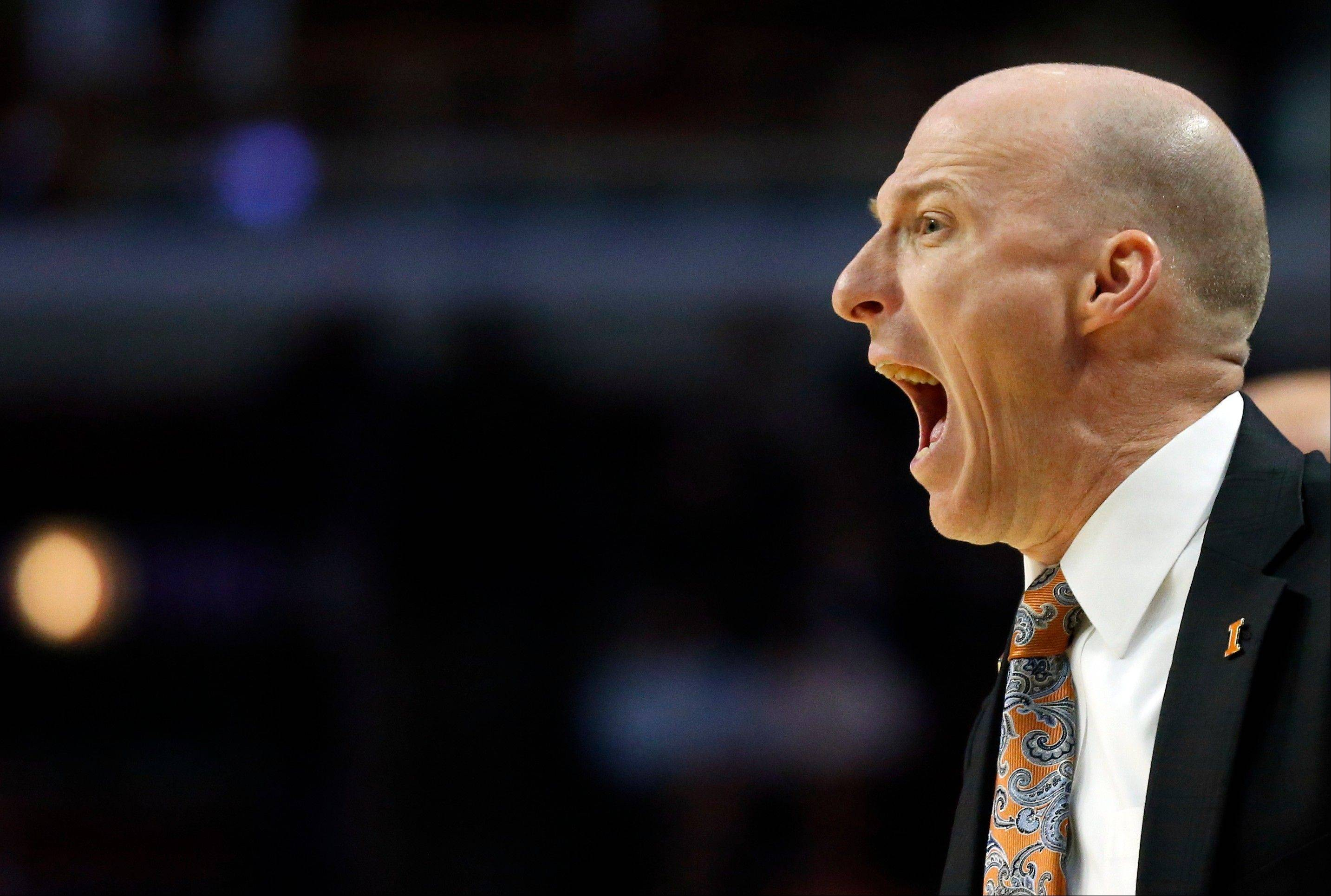 Illinois head coach John Groce provides direction for the Illini during their last-second win over Minnesota Thursday at the United Center.