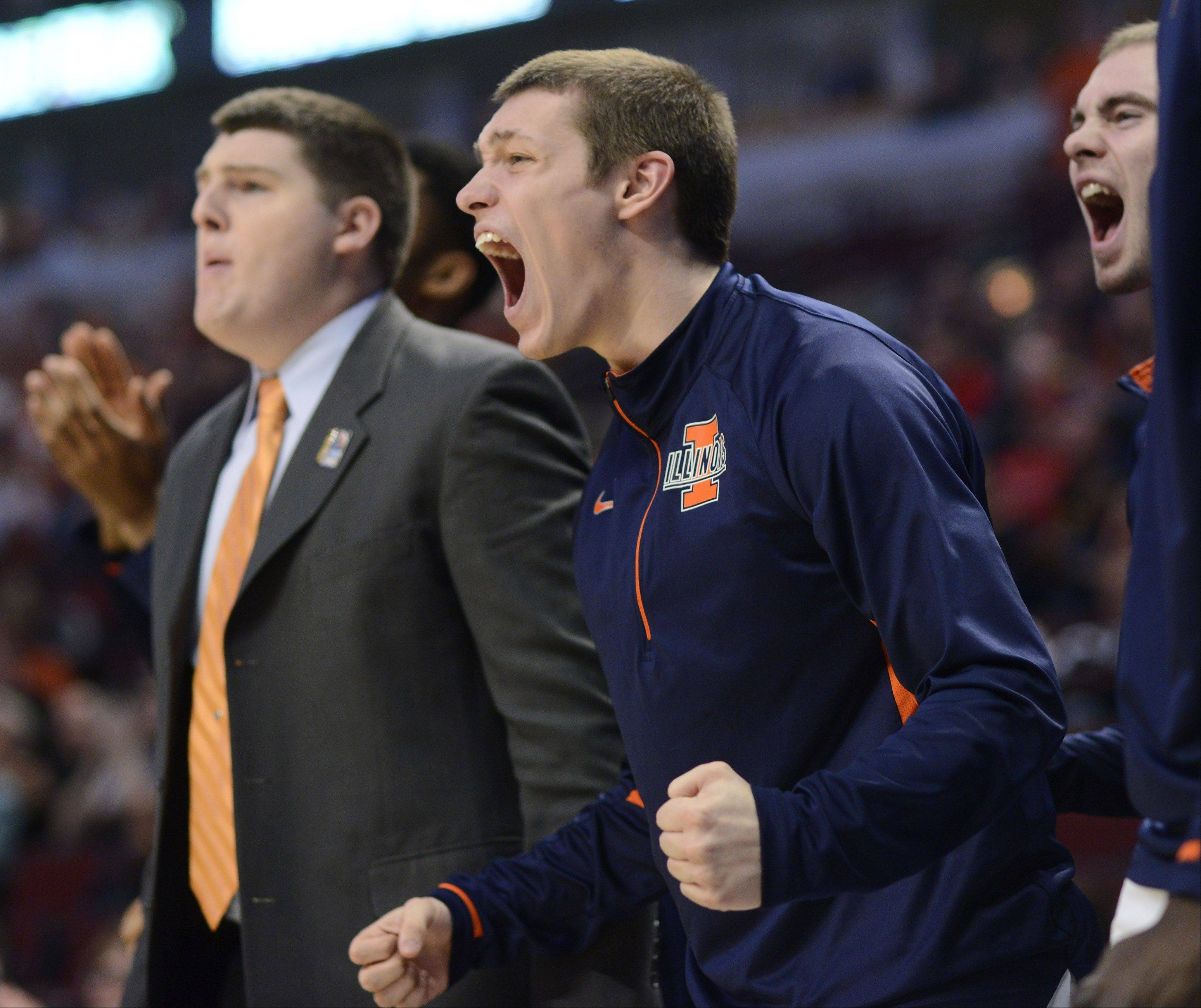 Illinois' Mike LaTulip cheers for his team from the bench.