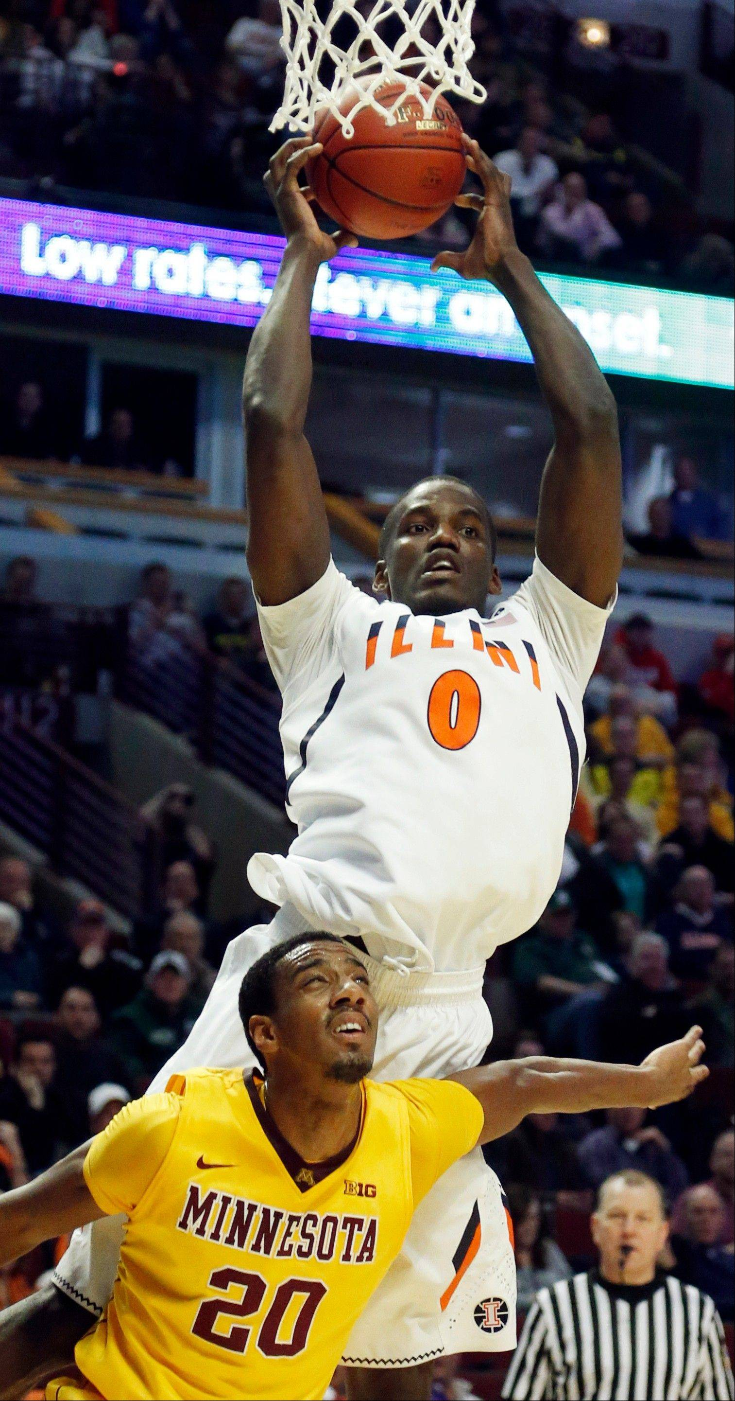 Illinois' Sam McLaurin rebounds over Minnesota's Austin Hollins (20) during the second half.